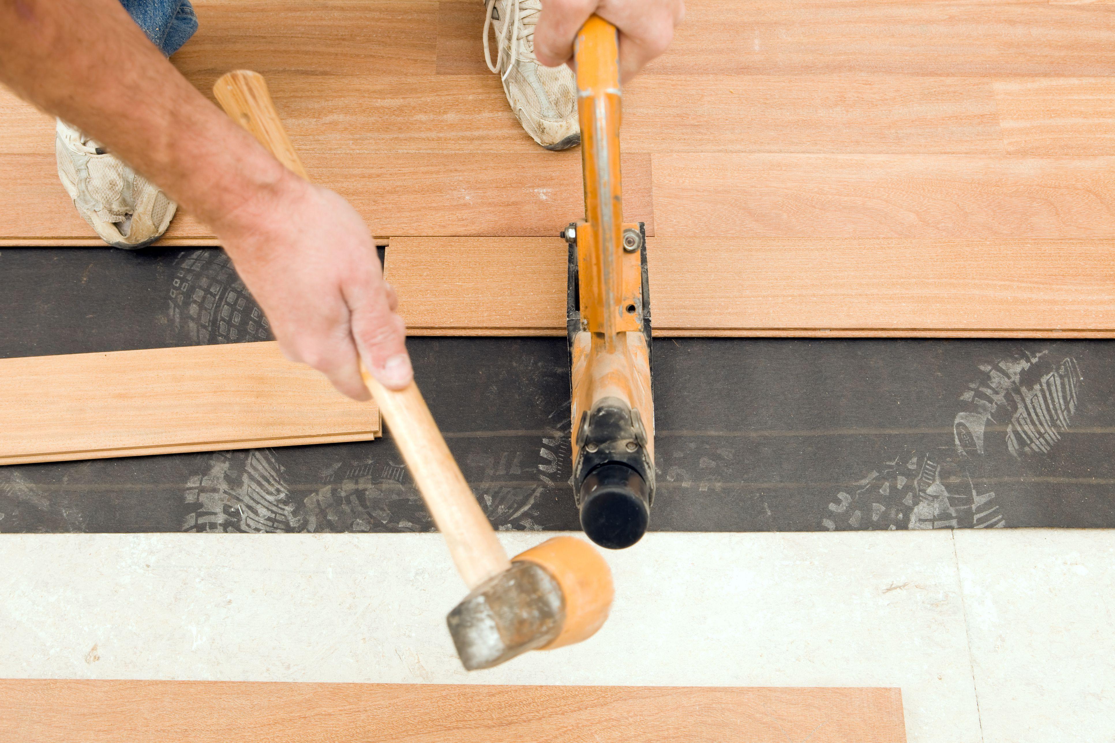 5 inch red oak hardwood flooring of the hardest wood flooring you can buy pertaining to worker installing new cumuru hardwood floor 186852280 5827f3bc5f9b58d5b11372fc