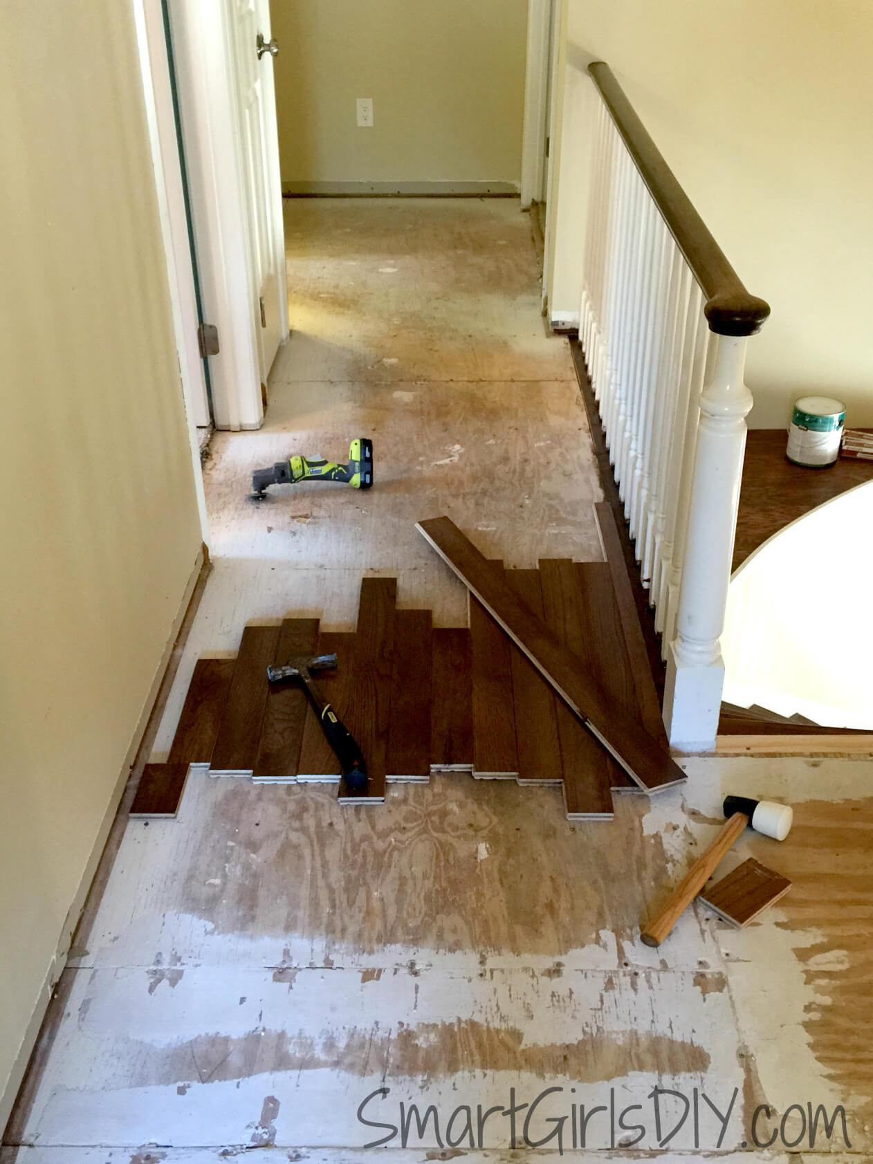 average cost to install hardwood flooring per square foot of upstairs hallway 1 installing hardwood floors with laying out bruce hardwood flooring first and second row of bruce hardwood being installed