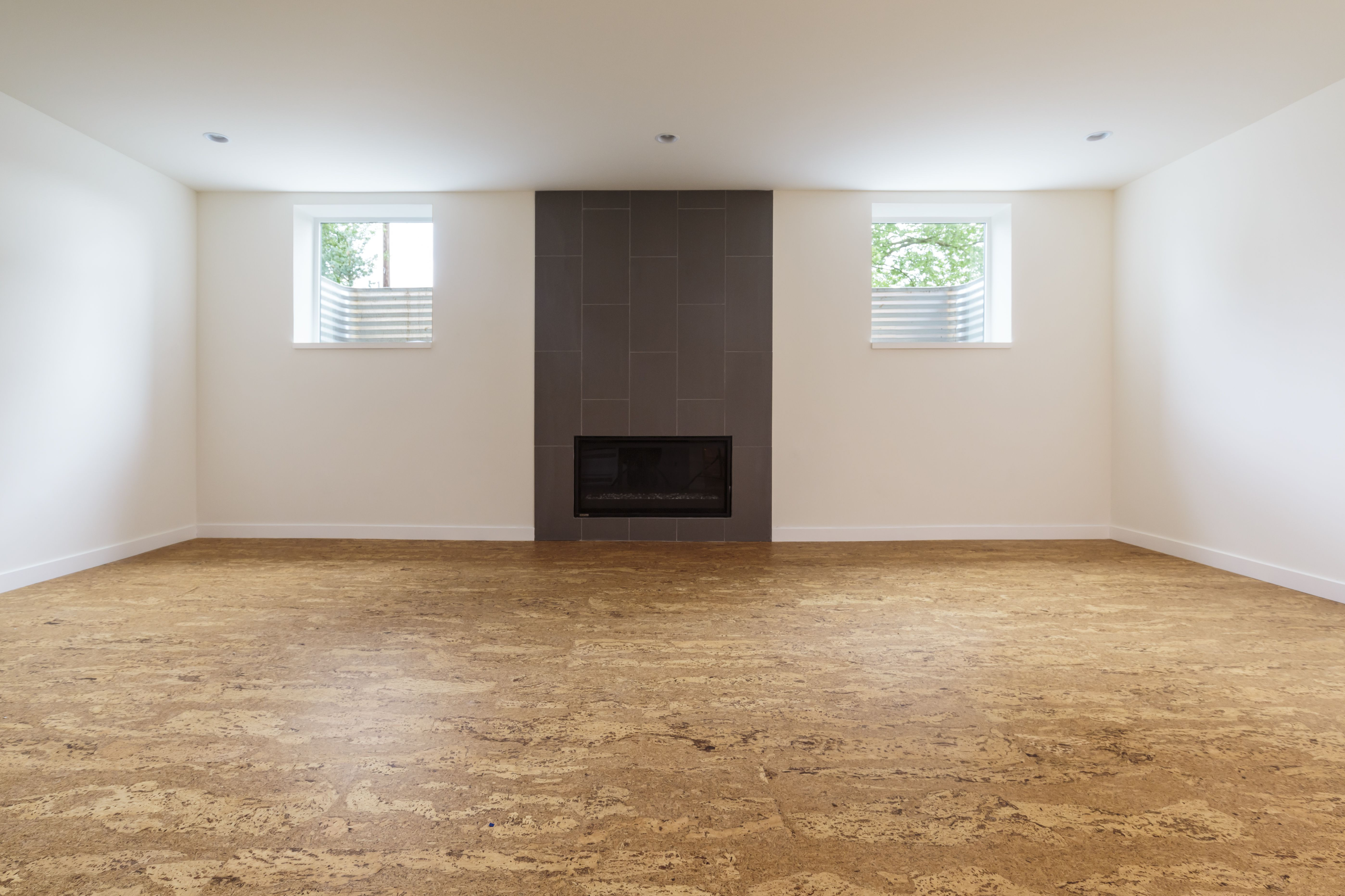 basement hardwood floor ideas of the best flooring options for senior citizens pertaining to cork flooring in an unfurnished home