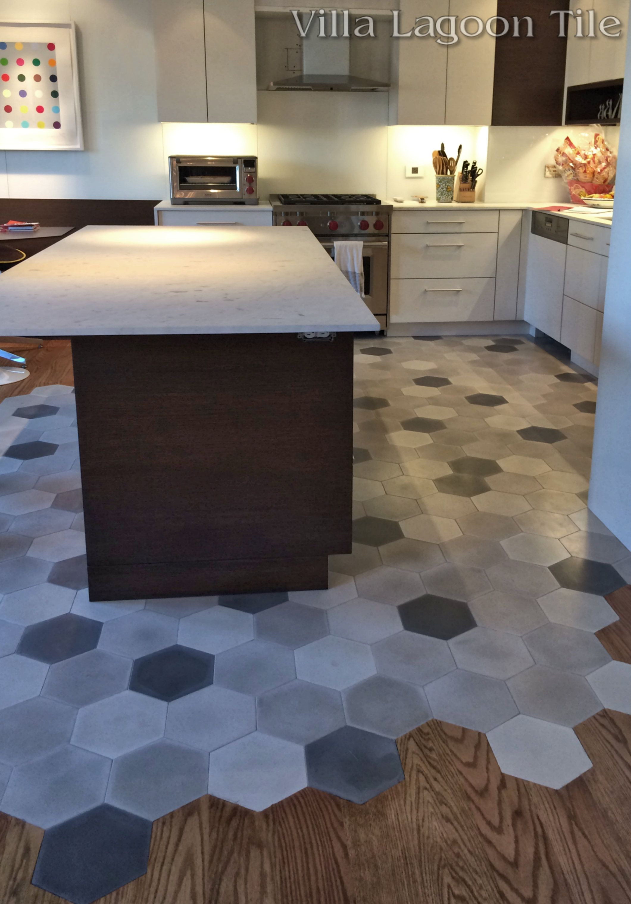 can hardwood floors be installed on concrete of this beautiful new york city installation flows hardwood floors into in this beautiful new york city installation flows hardwood floors into our mixed gray hex cement tile