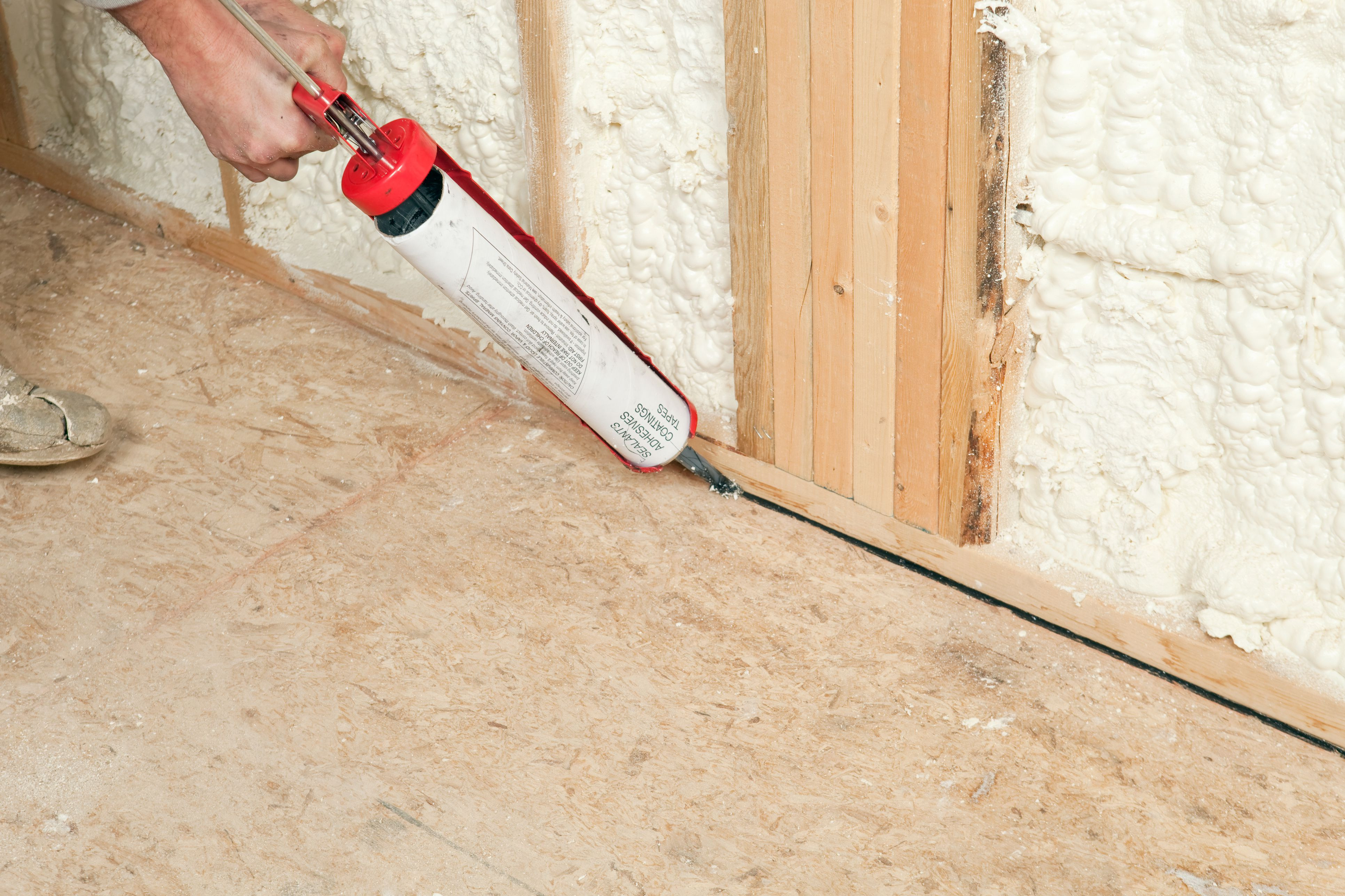 can you put hardwood floors over tile of osb oriented strand board sub flooring with regard to worker caulking wall plate to subfloor 185099682 57fa64803df78c690f7666e2