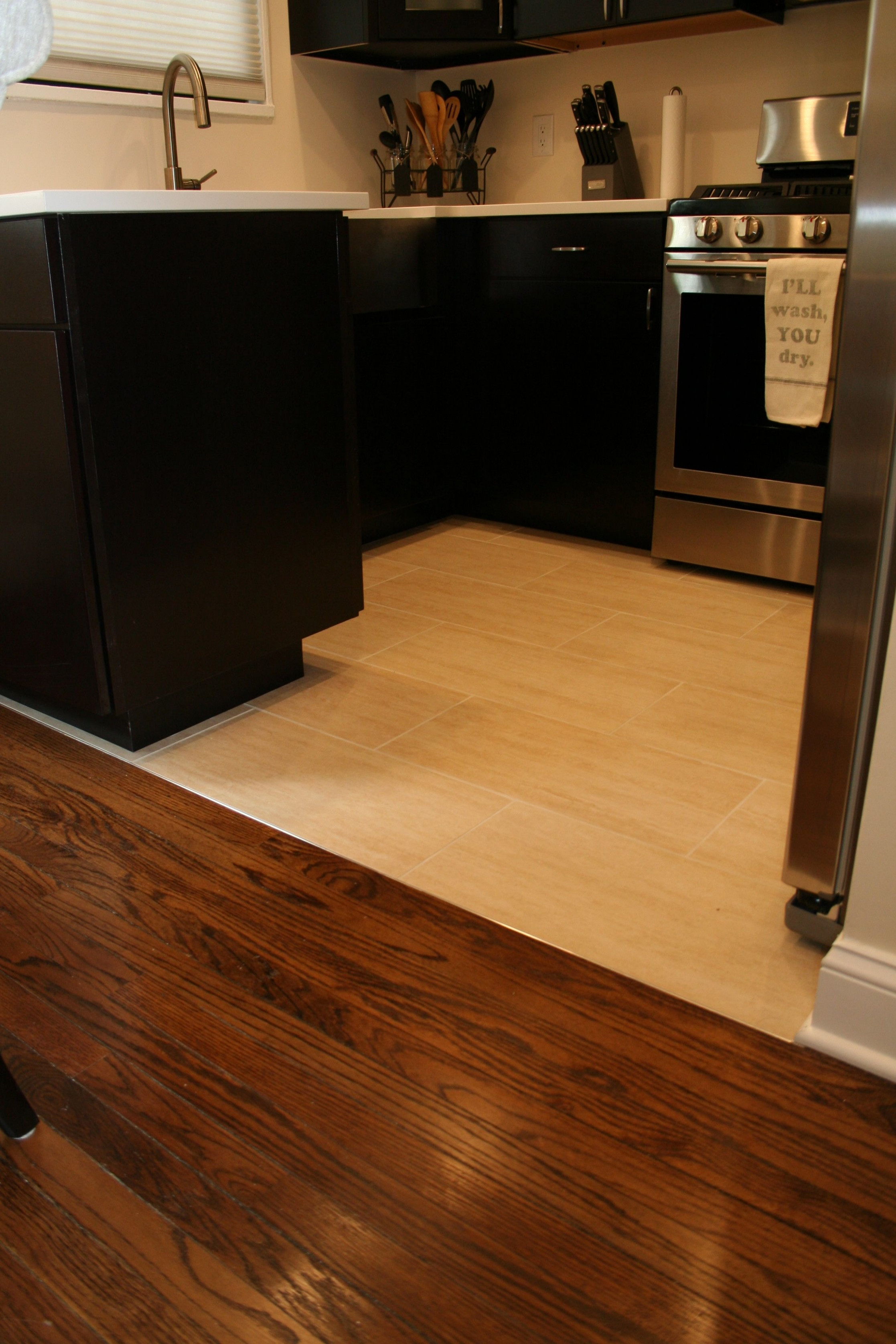dark hardwood floors in small spaces of what tile is best for kitchen floor and not dark jackolanternliquors in transition from tile to wood floors light to dark flooring kitchen cabinetsml