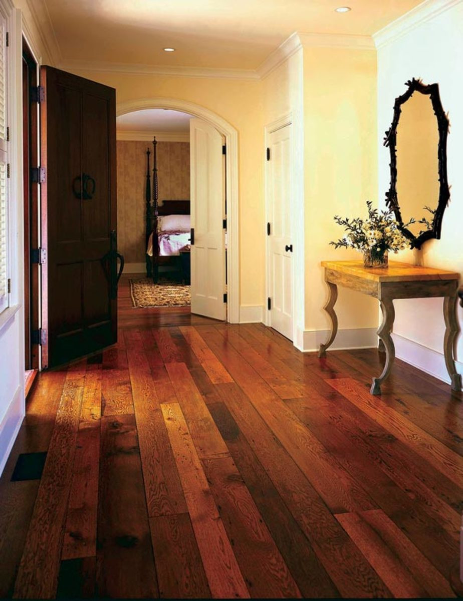 dark hardwood floors with white trim of the history of wood flooring restoration design for the vintage regarding reclaimed boards of varied tones call to mind the late 19th century practice of alternating