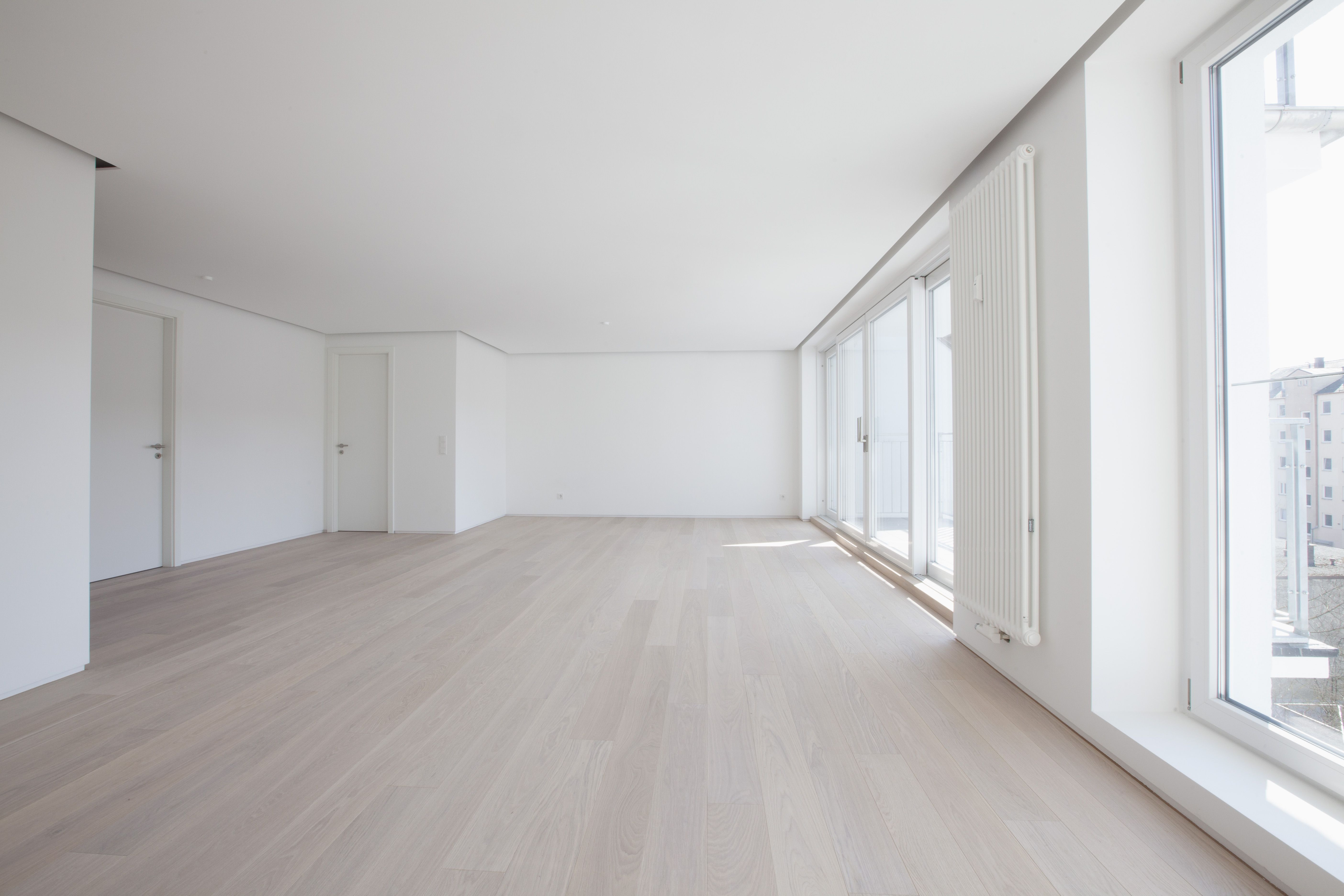 engineered hardwood flooring 3 8 vs 1 2 of basics of favorite hybrid engineered wood floors throughout empty living room in modern apartment 578189139 58866f903df78c2ccdecab05