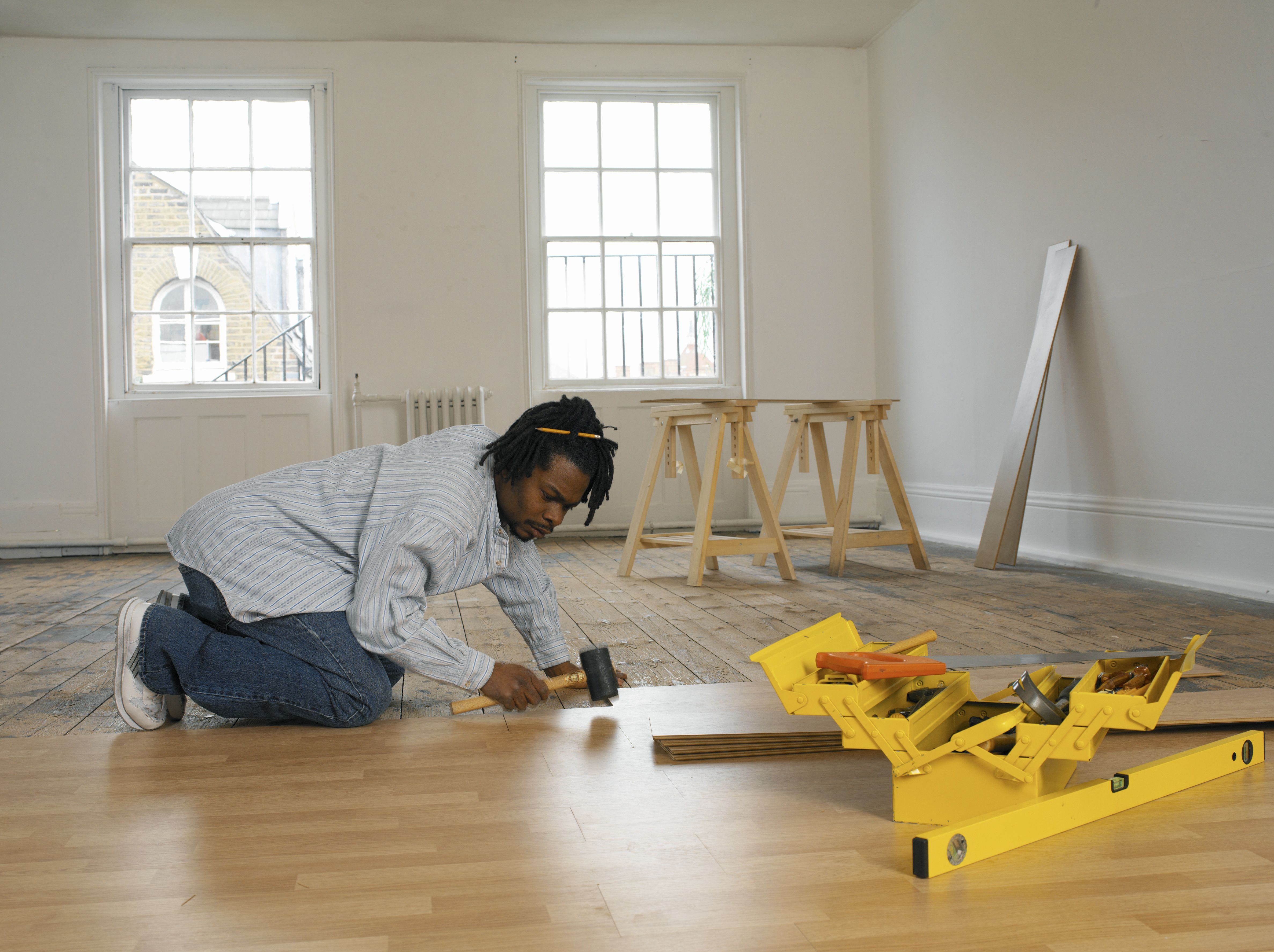 engineered hardwood flooring prices canada of ikea flooring review overview throughout young man laying floor 200199826 001 57e96a973df78c690f719440