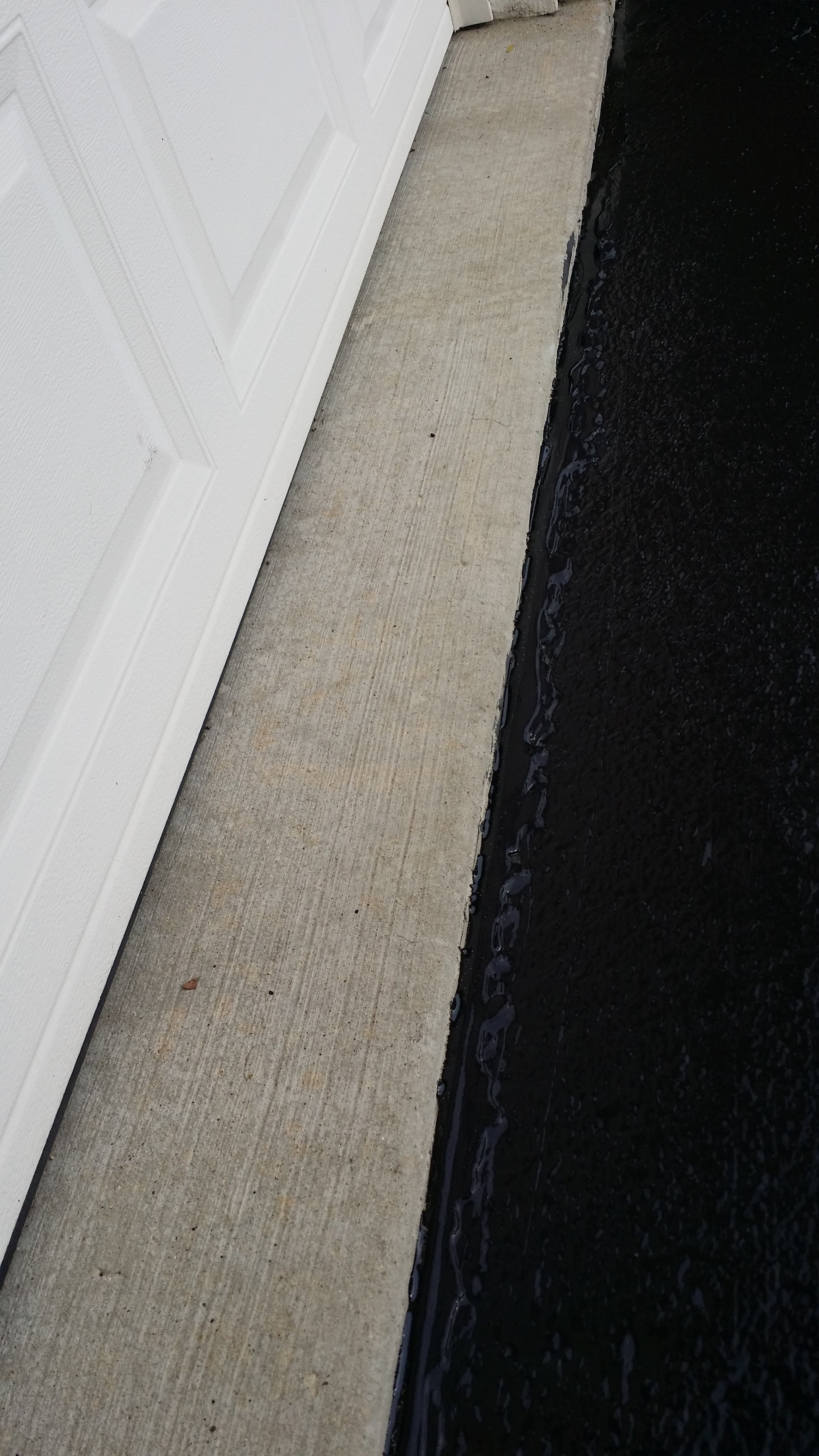 filling small gaps in hardwood floors of fill gap between driveway and concrete floor silva brothers inside we solve the problem filling the gap with a 450 f hot rubber material insulating the