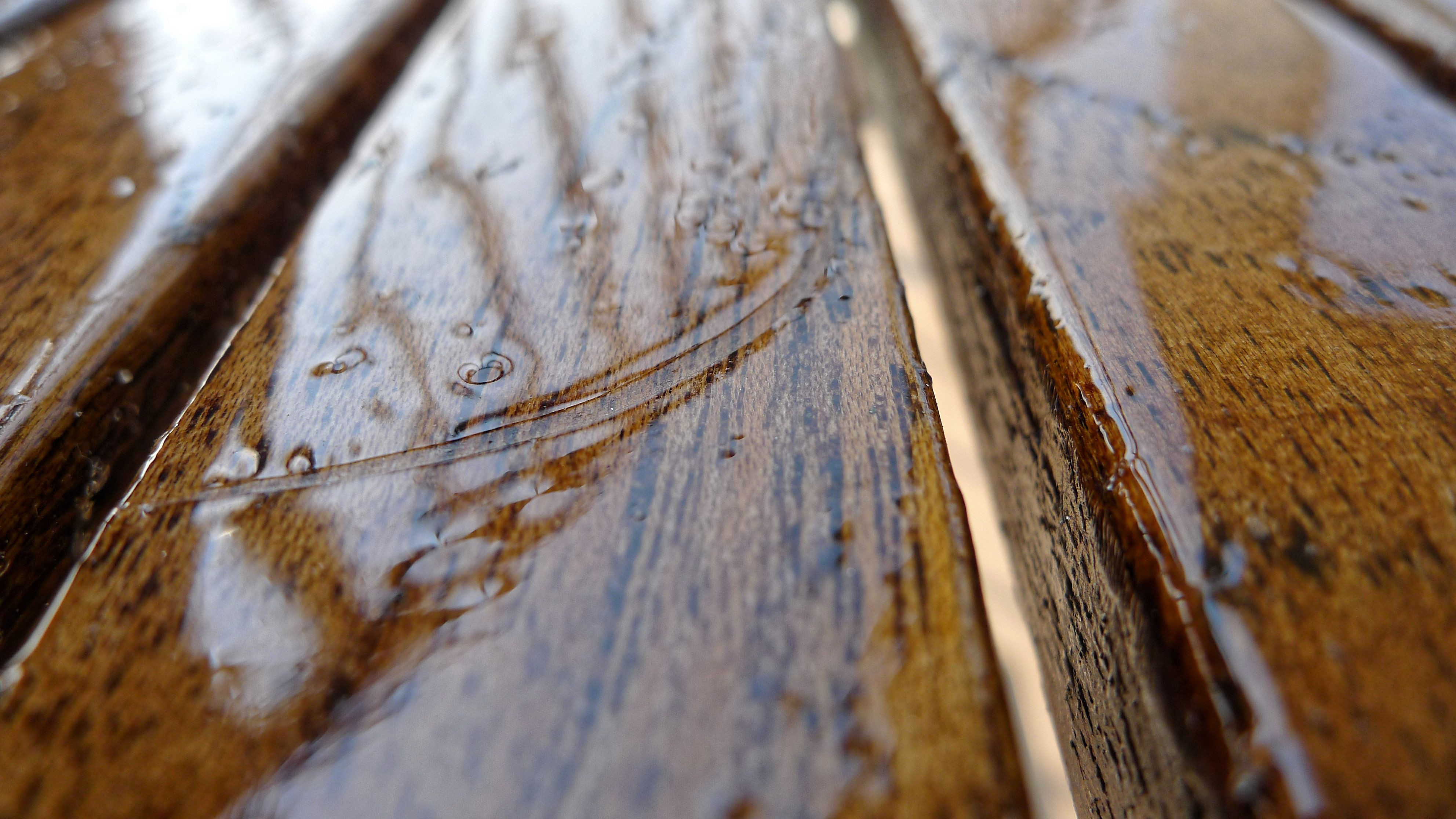 fixing large gaps in hardwood floors of how to save your water damaged wood floors intended for close up view of wet water surface 565793123 57ef31f73df78c690f863cff
