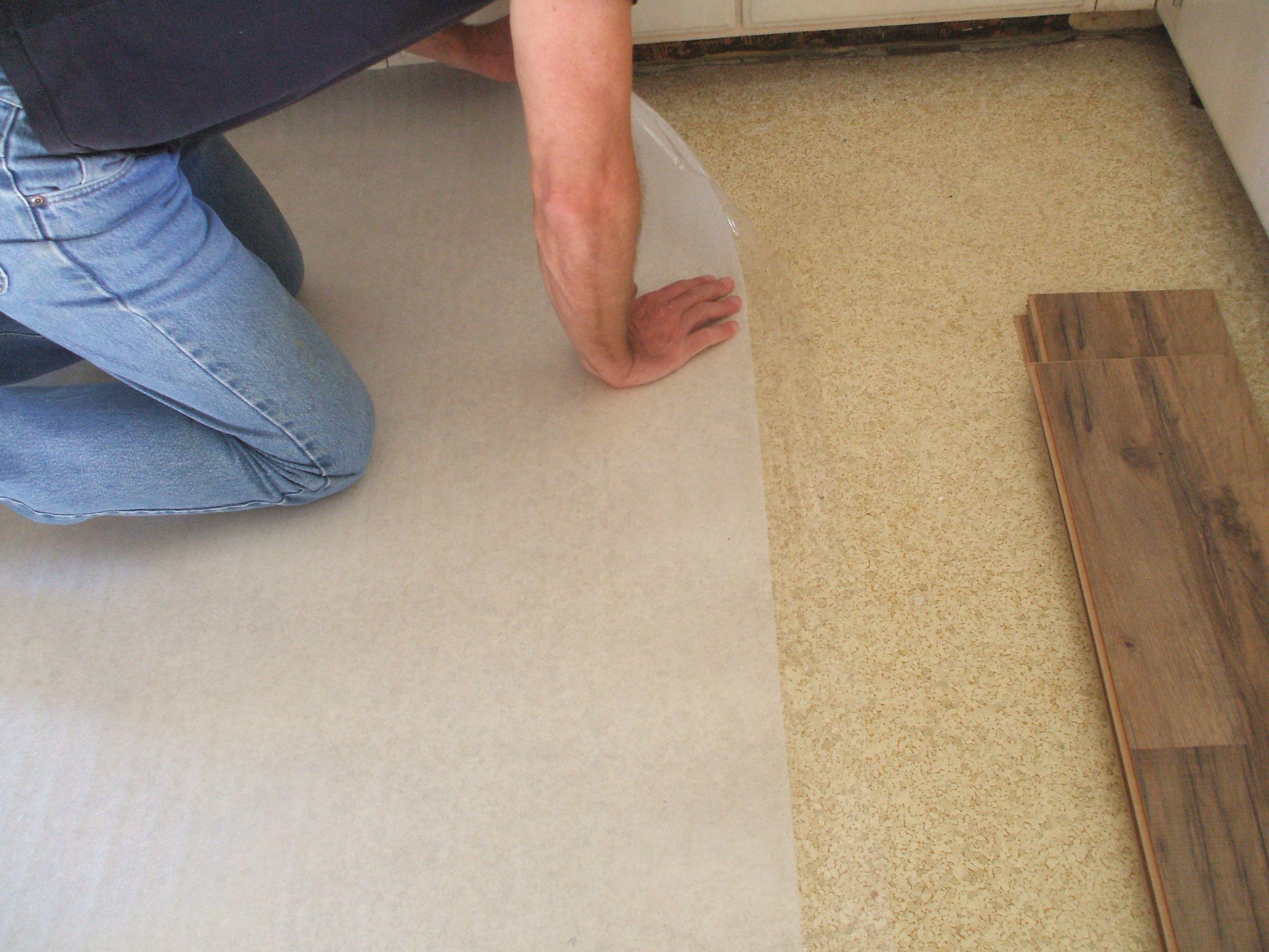 floating hardwood floor underlayment of laminate flooring installation made easy with installing laminate putting down underlayment 56a49e445f9b58b7d0d7dddd jpg