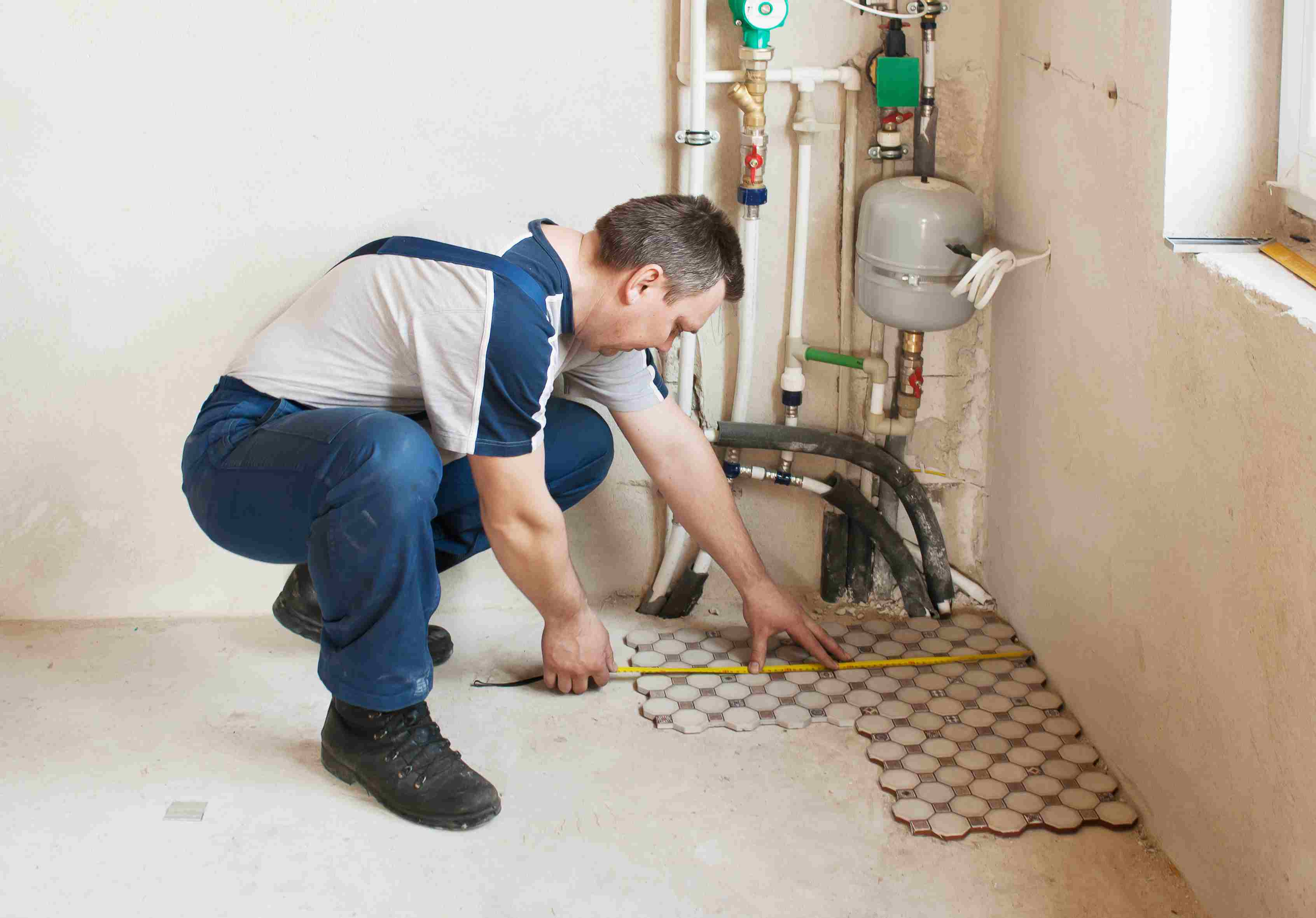 glue down hardwood floor problems of common flooring types currently used in renovation and building with man laying floor tiles in a new house 564186915 57e71c2c3df78c690f2fa431