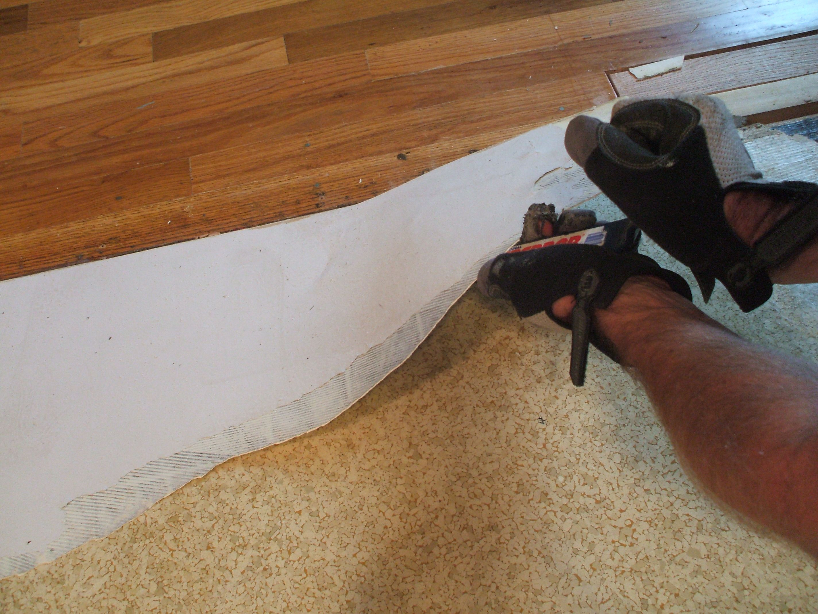 glue down hardwood floor repair of how to remove vinyl flooring with less effort and mess regarding remove vinyl use prybar on easy glued areas 56a49e3e5f9b58b7d0d7ddce jpg