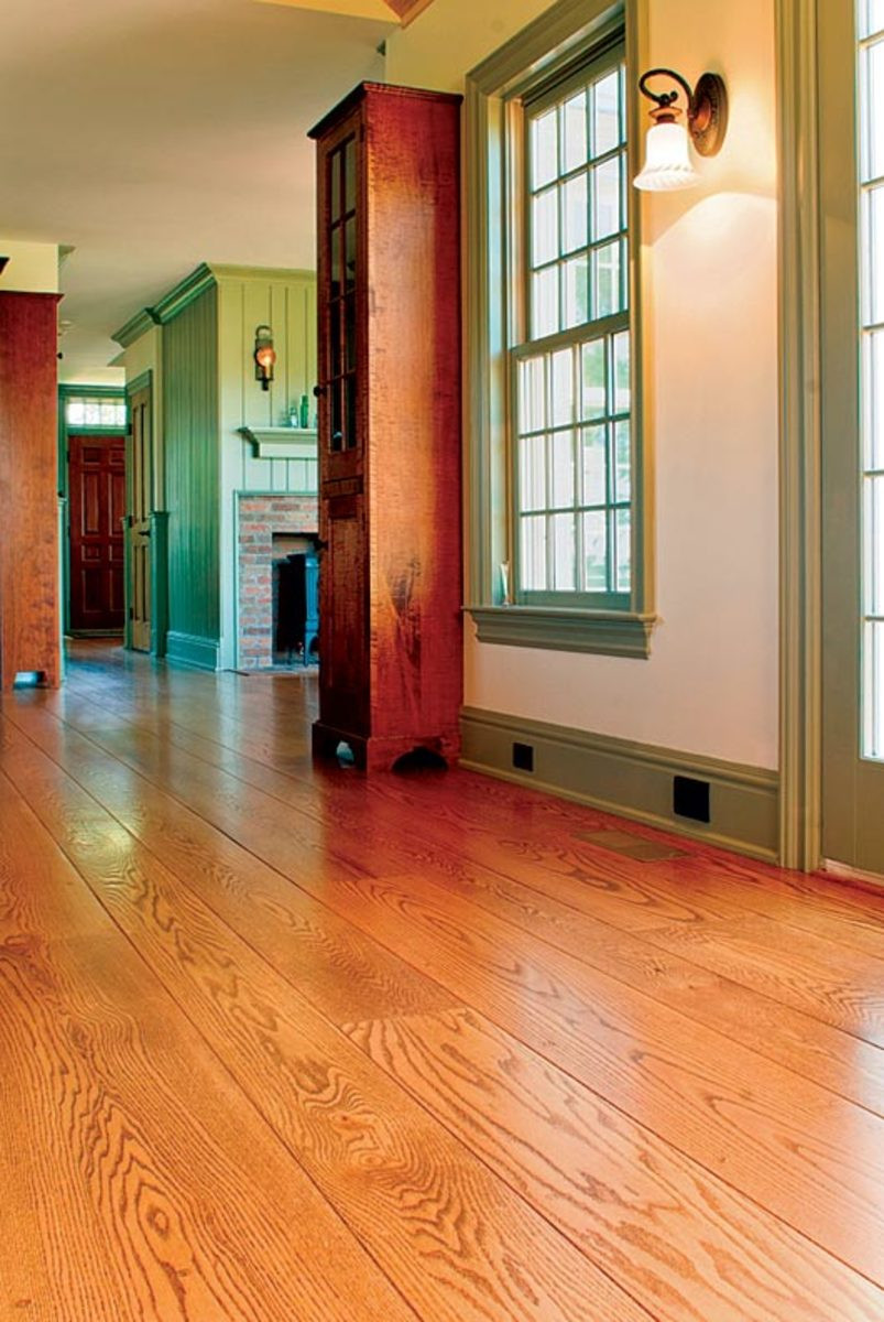 grey hardwood floors with dark furniture of the history of wood flooring restoration design for the vintage within using wide plank flooring can help a new addition blend with an old house