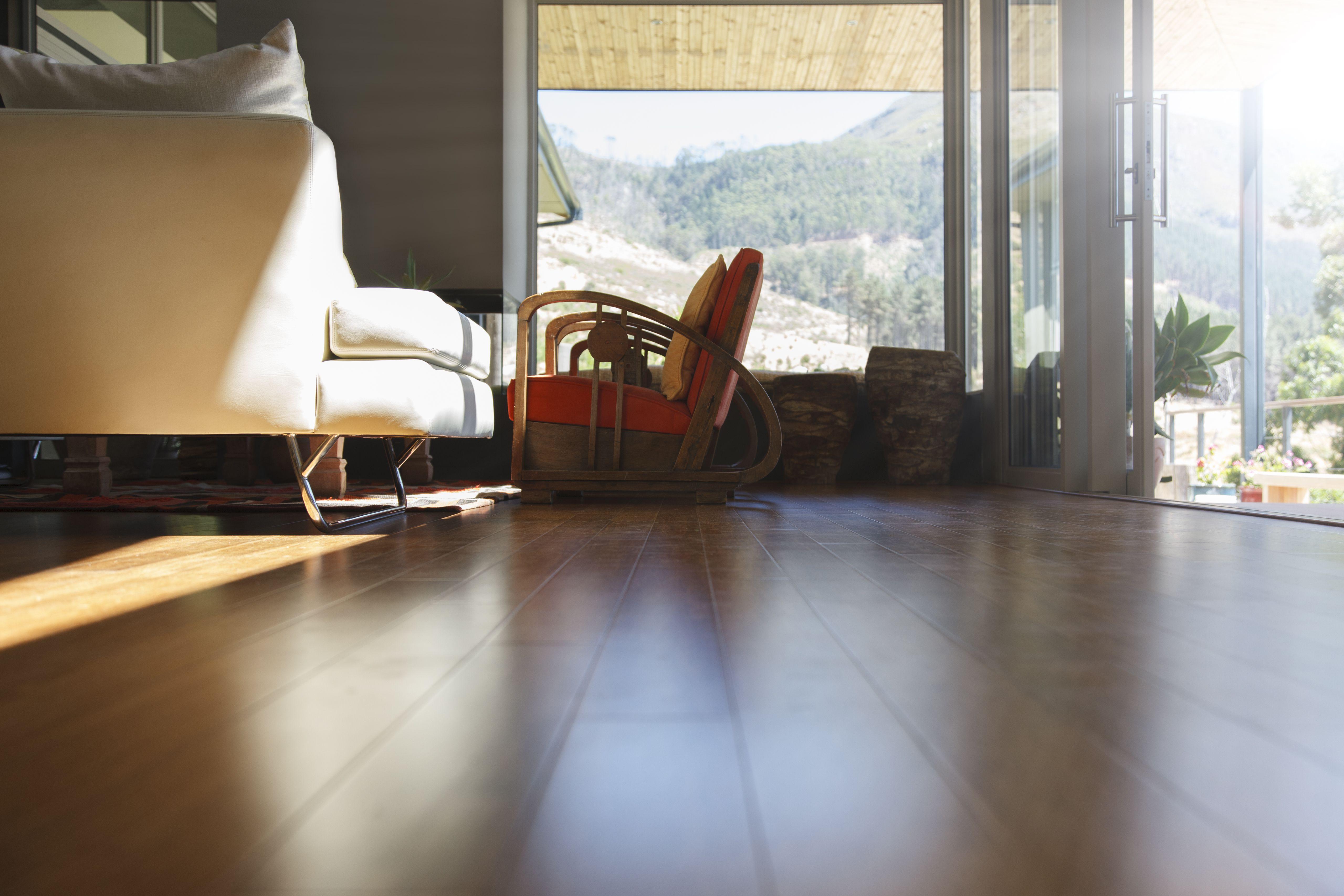 Hand Scraped Engineered Hardwood Flooring Pros and Cons Of Types Of Engineered Flooring From Premium Hardwoods within Living Room Interior Hard Wood Floor and sofa 525439899 5a764f241d64040037603c15