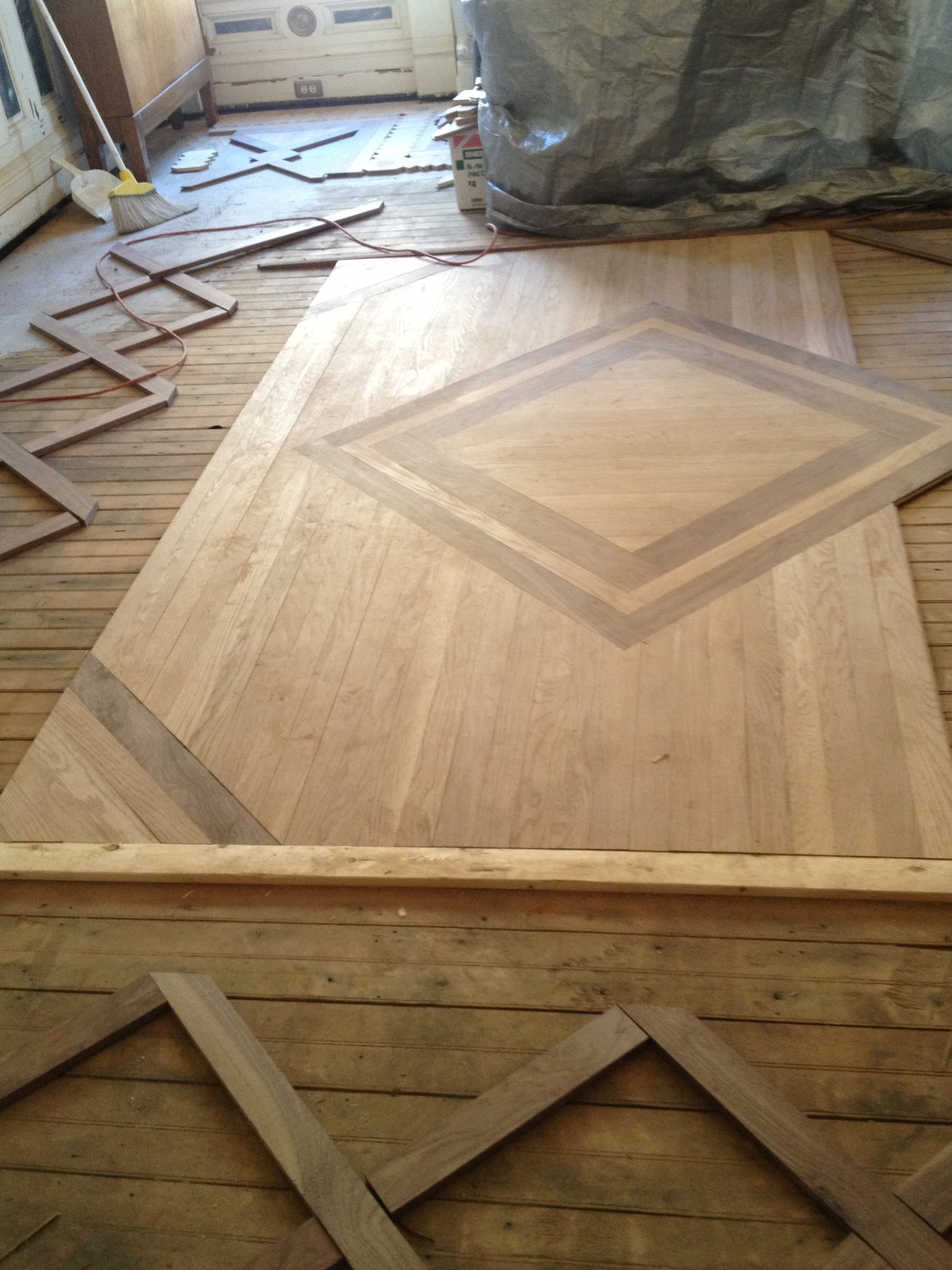 hardwood floor installation knoxville of explore the shakespeare chateau inn and gardens intended for here shown at left the faithful reproduction of the parquet floor in the dining room the original floor suffered irreparable water damage during and