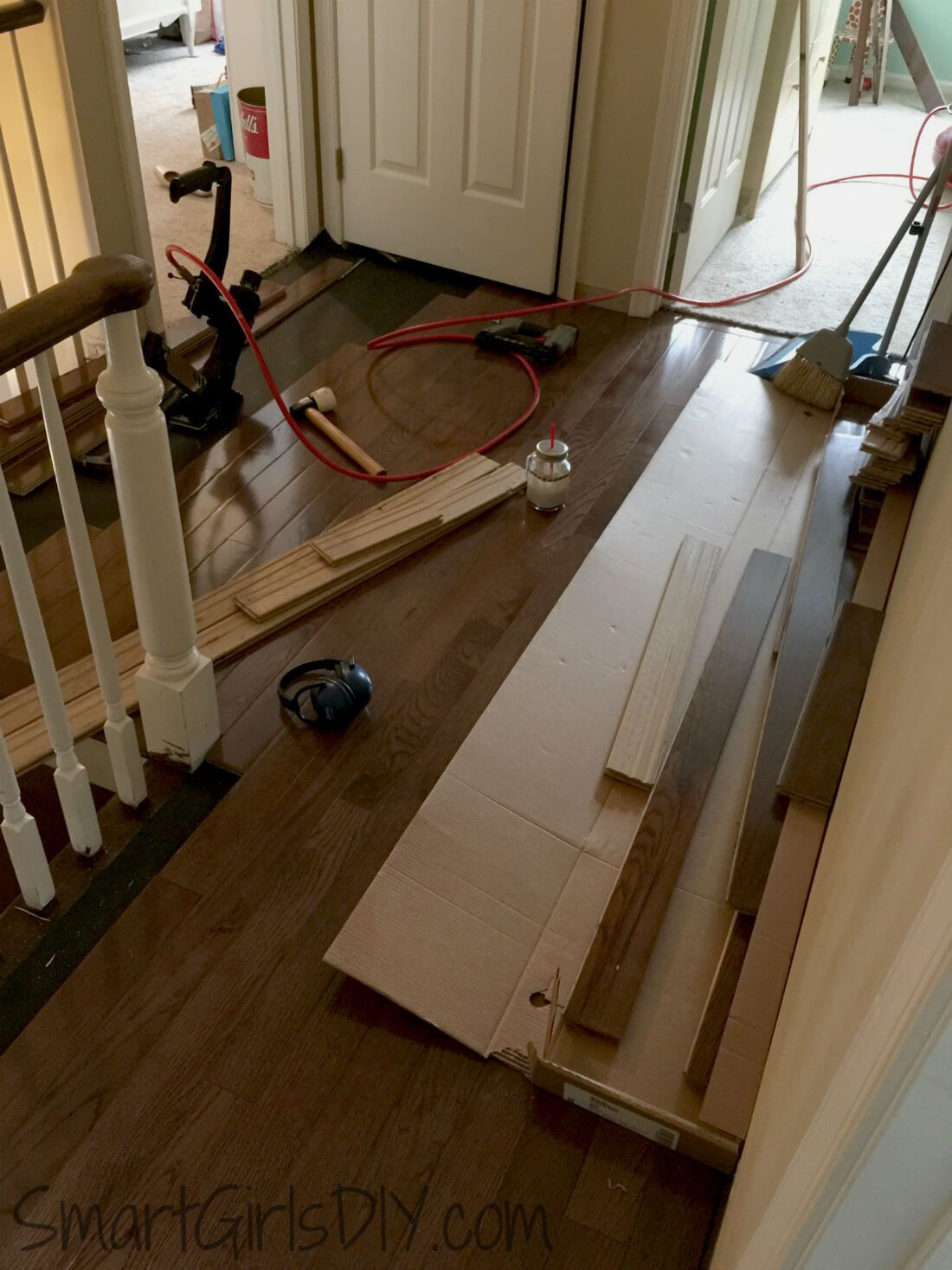 hardwood floor meets carpeted stairs of upstairs hallway 1 installing hardwood floors with how to install hardwood floor all by yourself