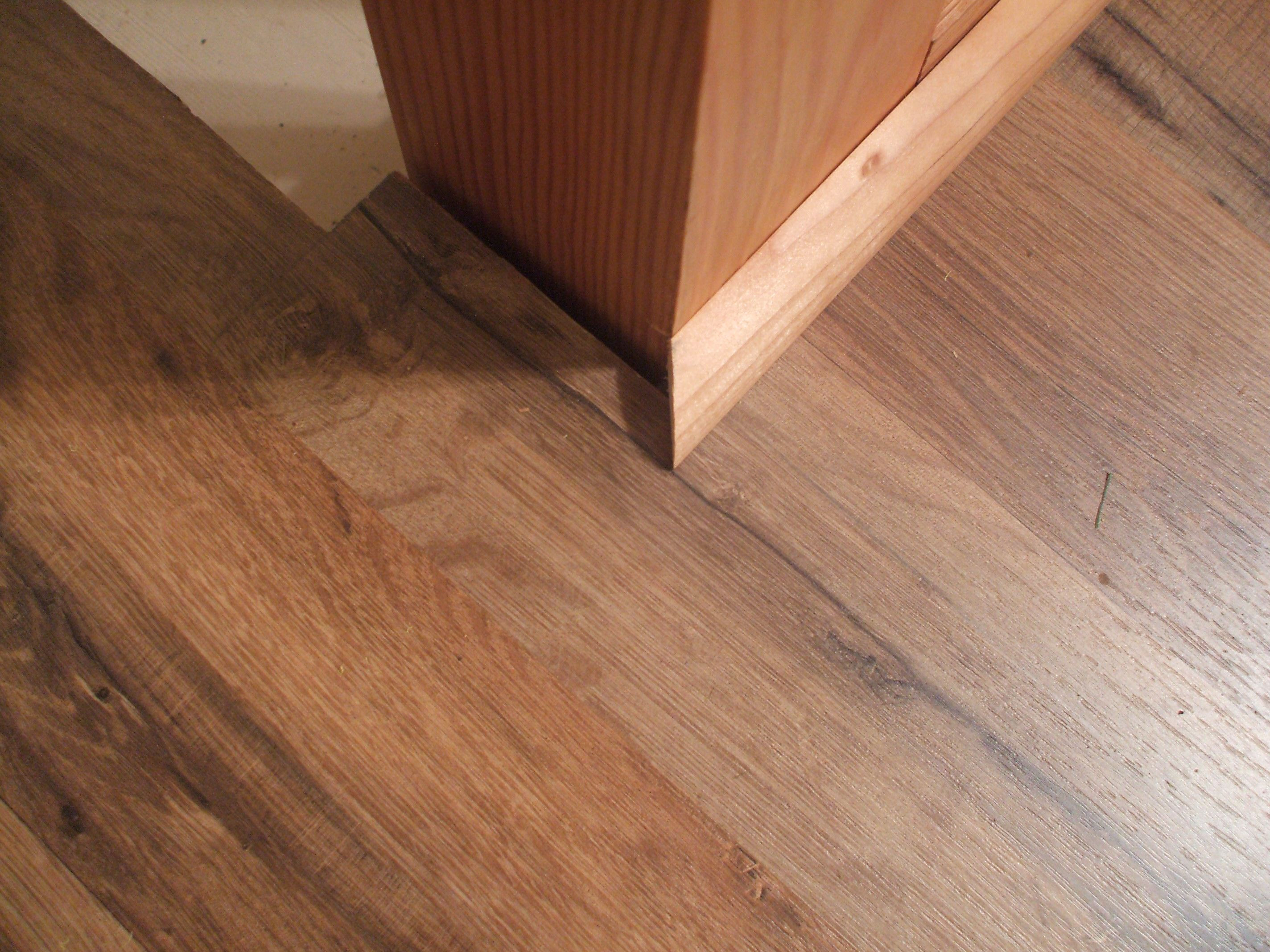 hardwood floor molding types of how to install shoe molding or quarter round molding intended for set first piece in place 56a49e523df78cf772834b40 jpg