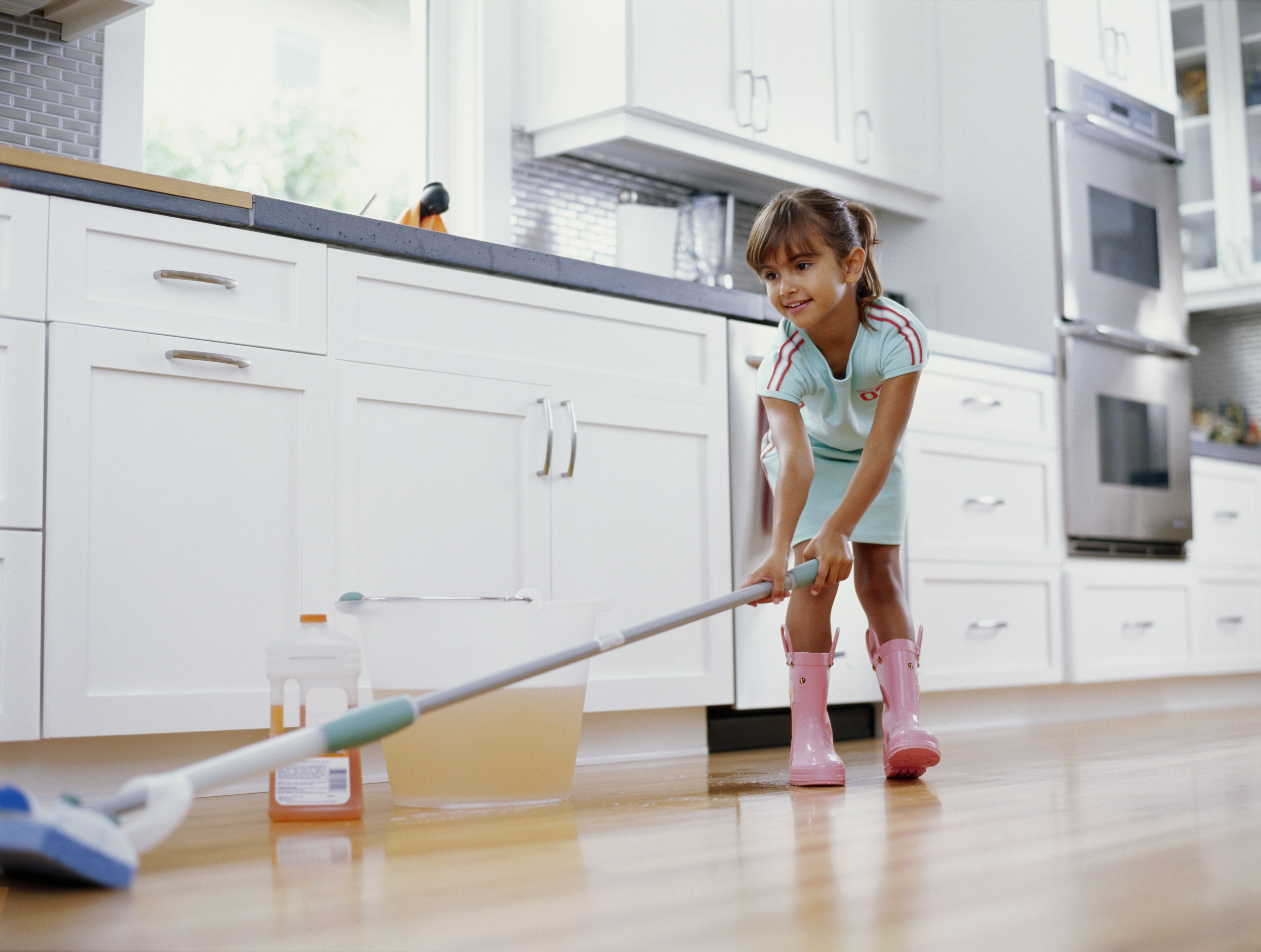 hardwood floor mop kit of 6 common mop types and what to use them for pertaining to girl 6 8 cleaning kitchen floor with mop smiling low angle view 200283537 001 59fb7c63845b34003850e855