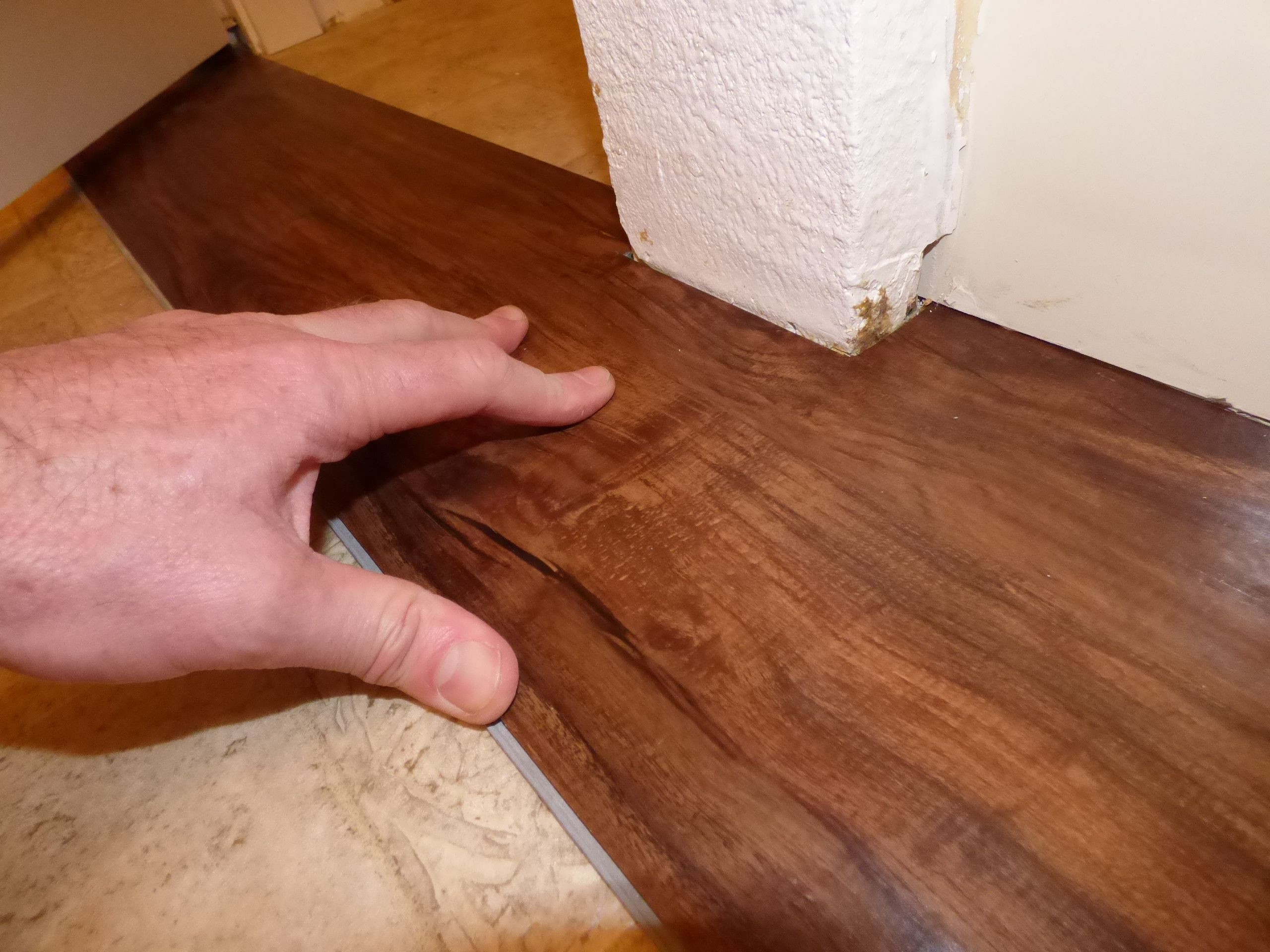 hardwood floor nail gun reviews of its easy and fast to install plank vinyl flooring throughout fitting plank around protrusions 56a4a04f3df78cf7728350a3 jpg