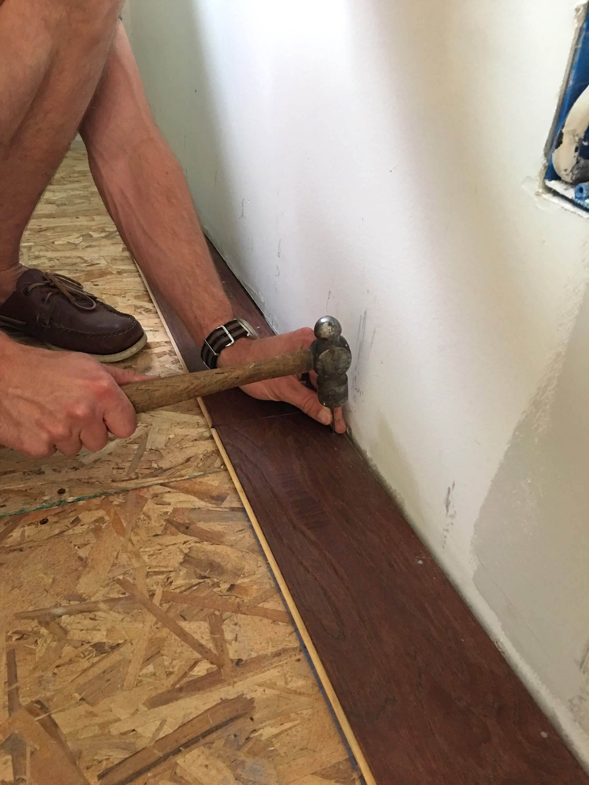 hardwood floor nailer hammer of the micro dwelling project part 5 flooring the daring gourmet pertaining to once the first row is installed the rest of the flooring can be secured using an air stapler you staple it every 4 6 inches along the floorboard and also