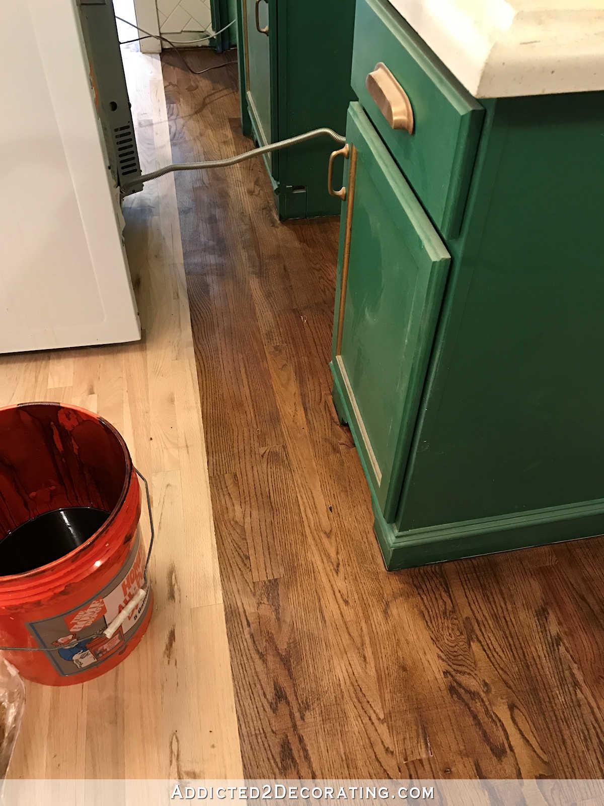 hardwood floor refinishing process of adventures in staining my red oak hardwood floors products process in staining red oak hardwood floors 10 stain on kitchen floor behind stove and refrigerator