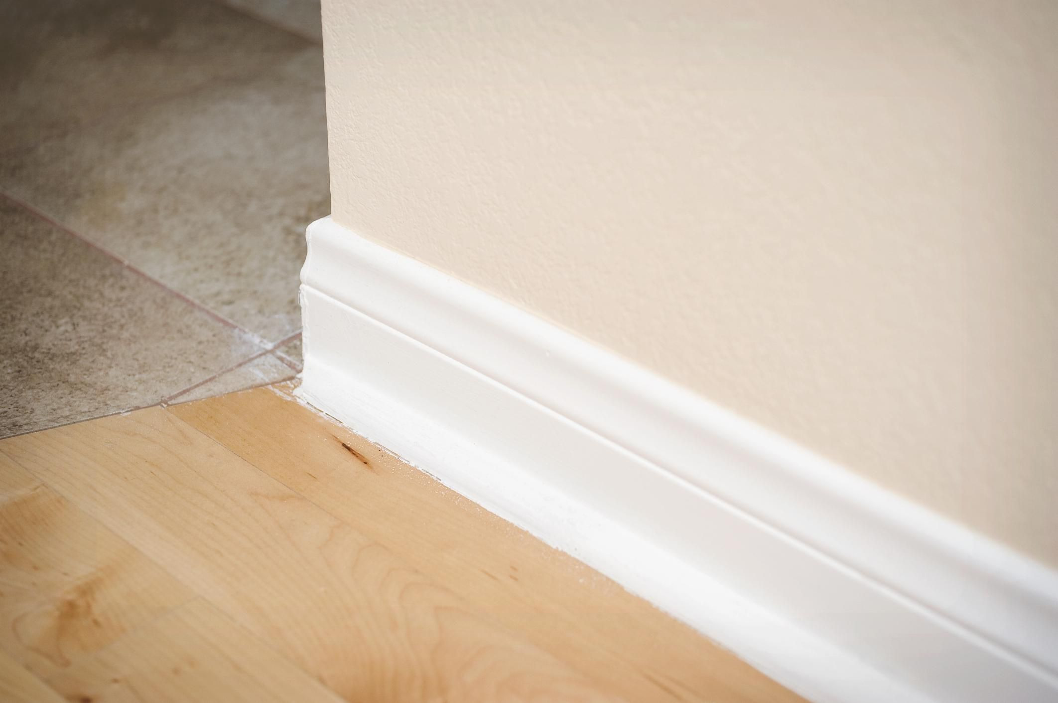 hardwood floor refinishing techniques of how to paint baseboards advice and hacks for 150207475 56a49f1b5f9b58b7d0d7e0d6