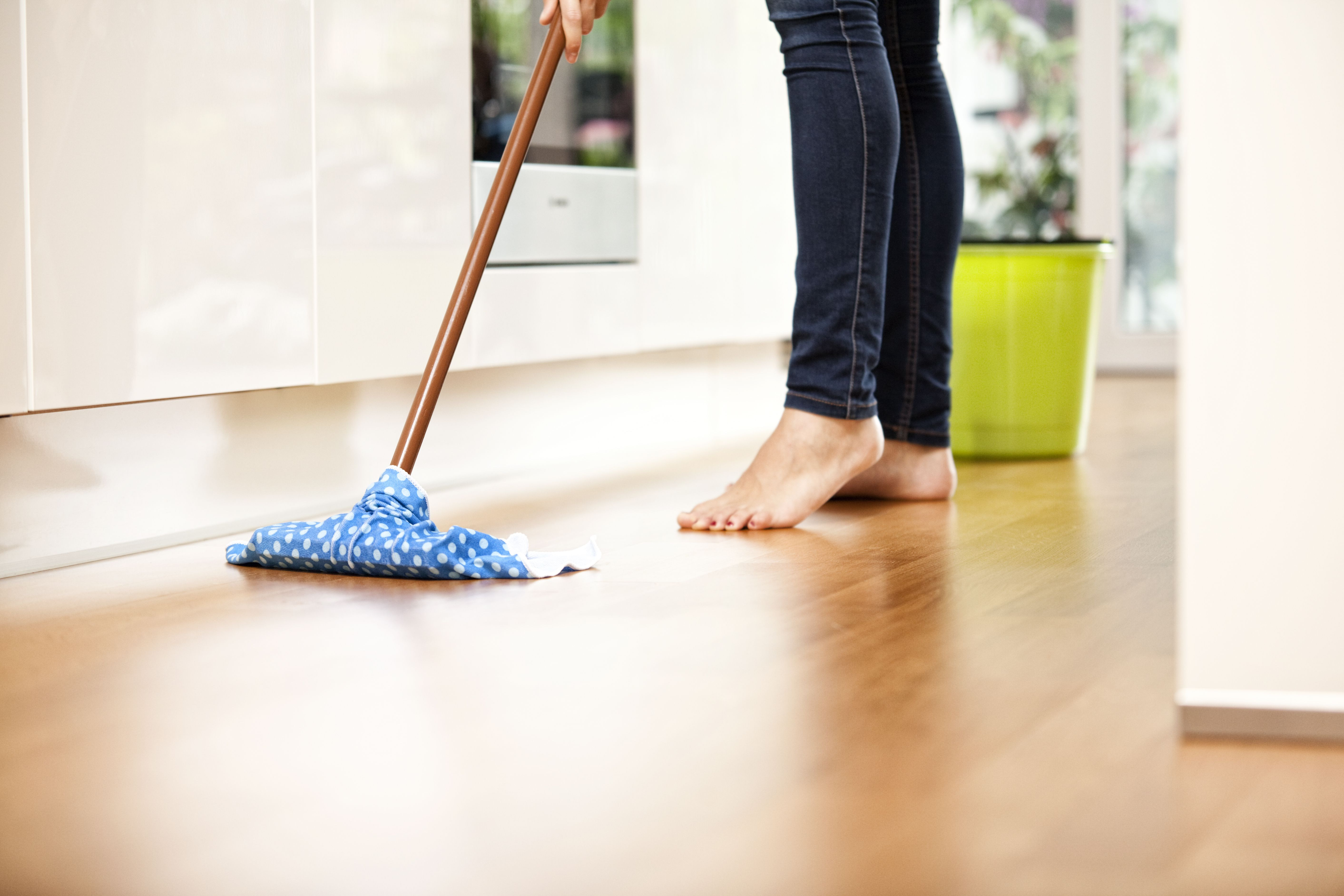 hardwood floor refinishing yorktown va of the right cleaners for your solid hardwood flooring throughout woman wiping the floor 588494585 585049b43df78c491ebc200a