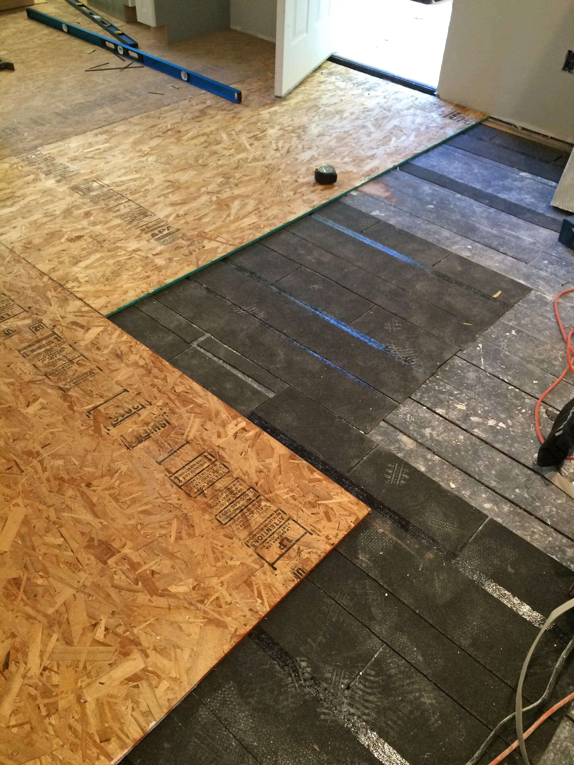 hardwood floor transition to sliding door of the micro dwelling project part 5 flooring the daring gourmet intended for we secured the sub flooring with construction screws its generally recommended to space the screws every 8 inches in a grid pattern