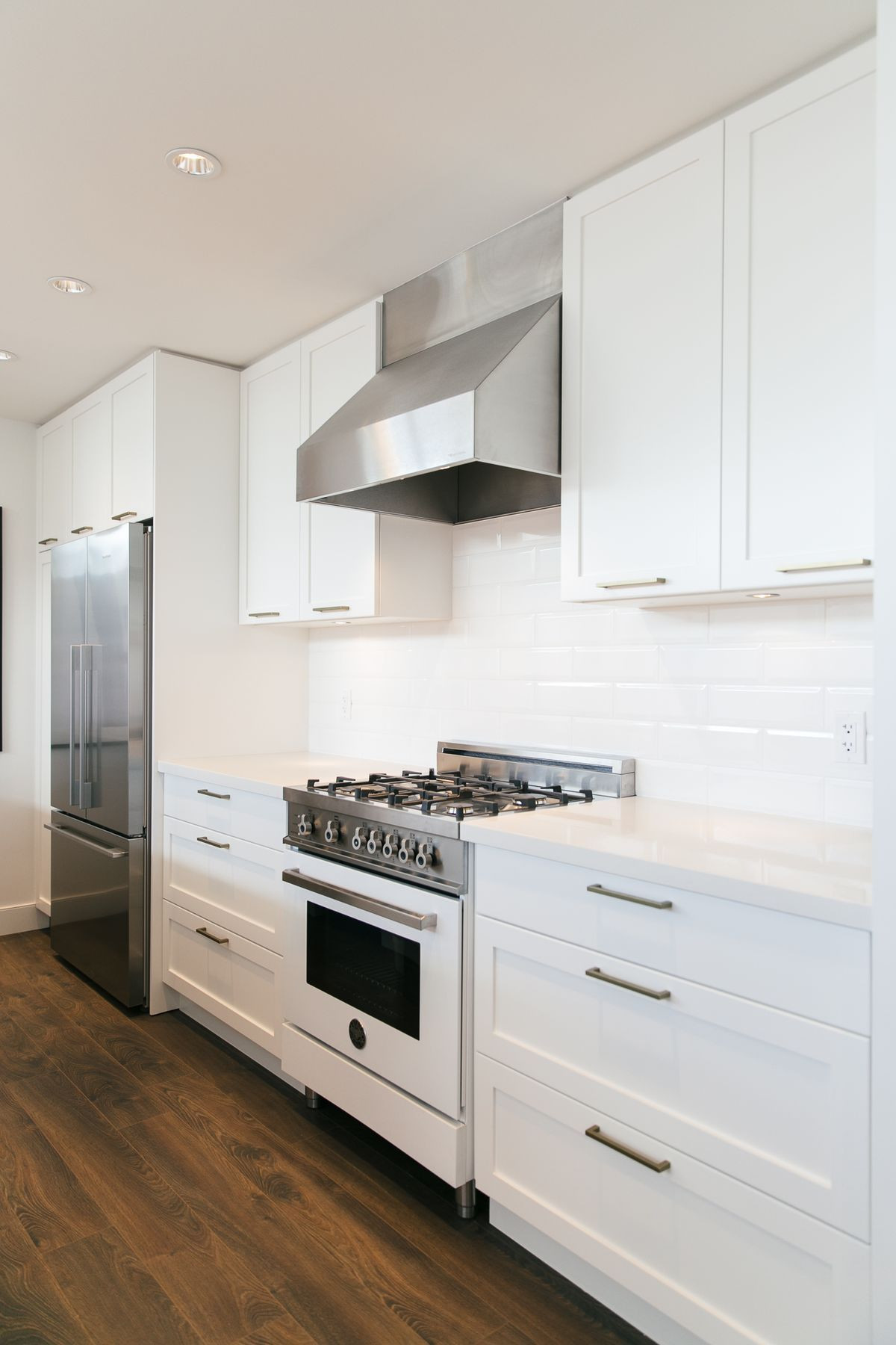 hardwood flooring auction calgary of bertazzoni range for modern kitchen design ideas with stainless throughout range hood white kitchen design ideas with white bertazzoni range and stainless steel range hood plus wooden flooring also recessed ceiling lighting