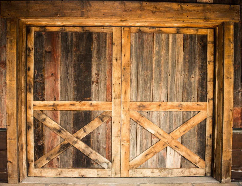 hardwood flooring green bay wi of reclaimed wood species distinguished boards beams throughout weathered grey pine and mixed oak barn wood siding garage door in a traditional barn style