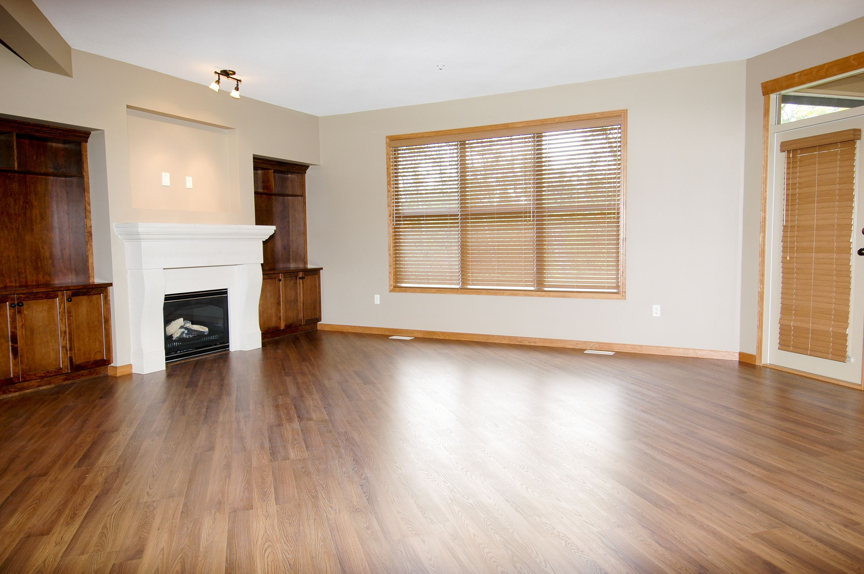 hardwood floors upstairs noise of how to reduce and prevent static on laminate flooring within large empty room with fireplace and wood flooring 172401085 587573903df78c17b6de8379