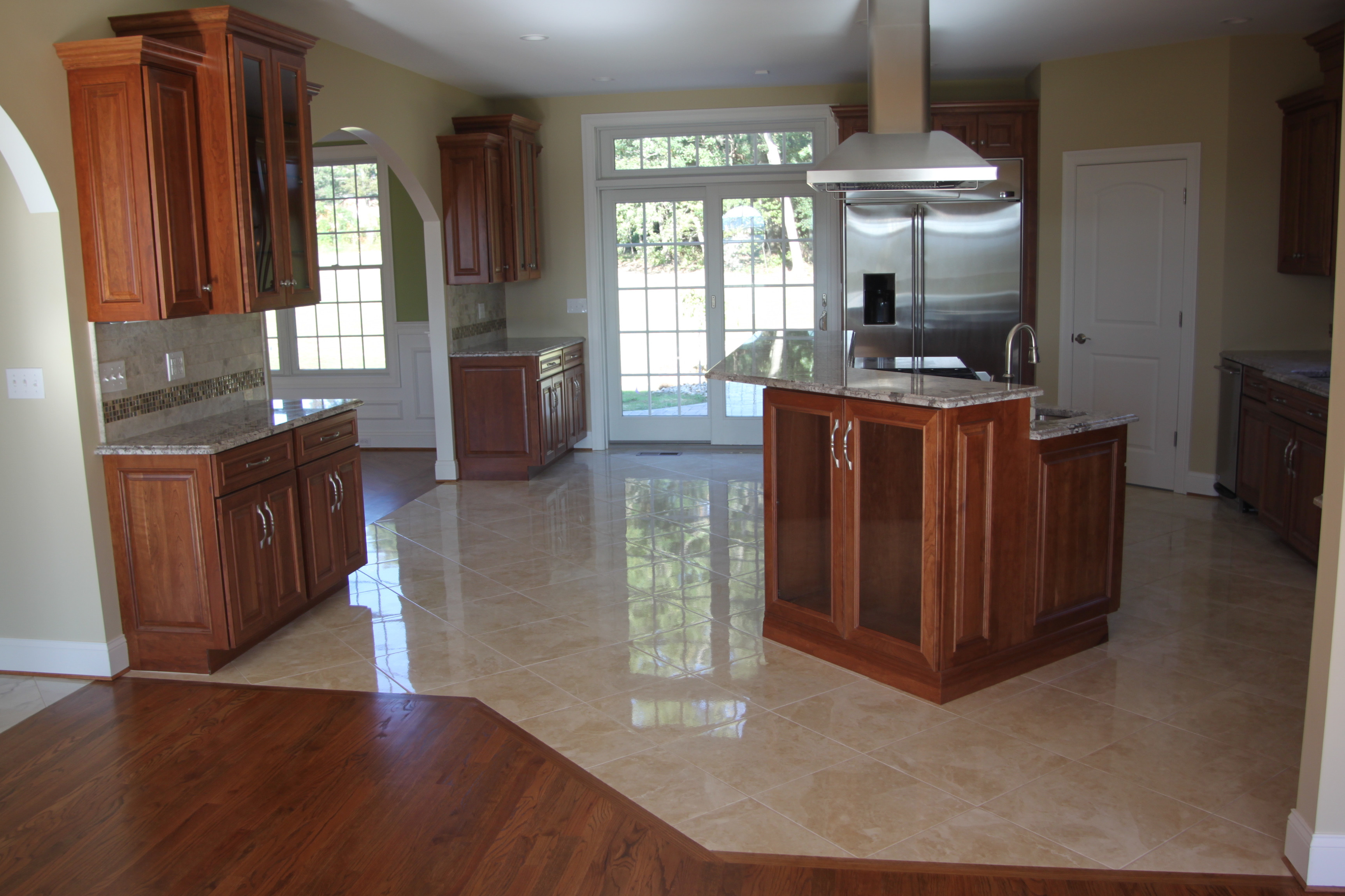 hardwood floors vs porcelain tile of should your flooring match your kitchen cabinets or countertops with floor wall tile
