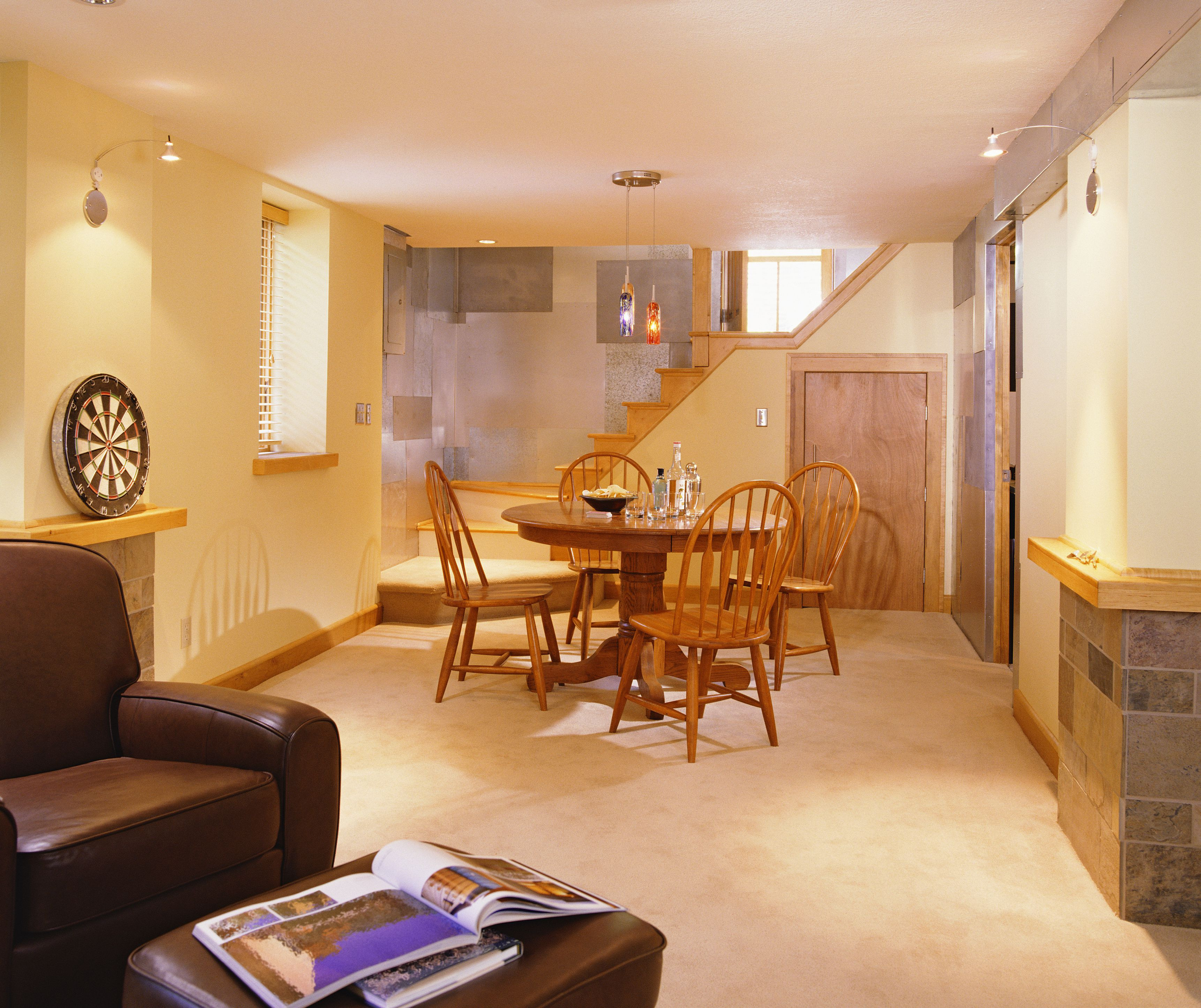hardwood on concrete basement floor of laminate flooring in a basement setting pertaining to finished basement with metal paneling 523364566 59fcde94aad52b003781f53b
