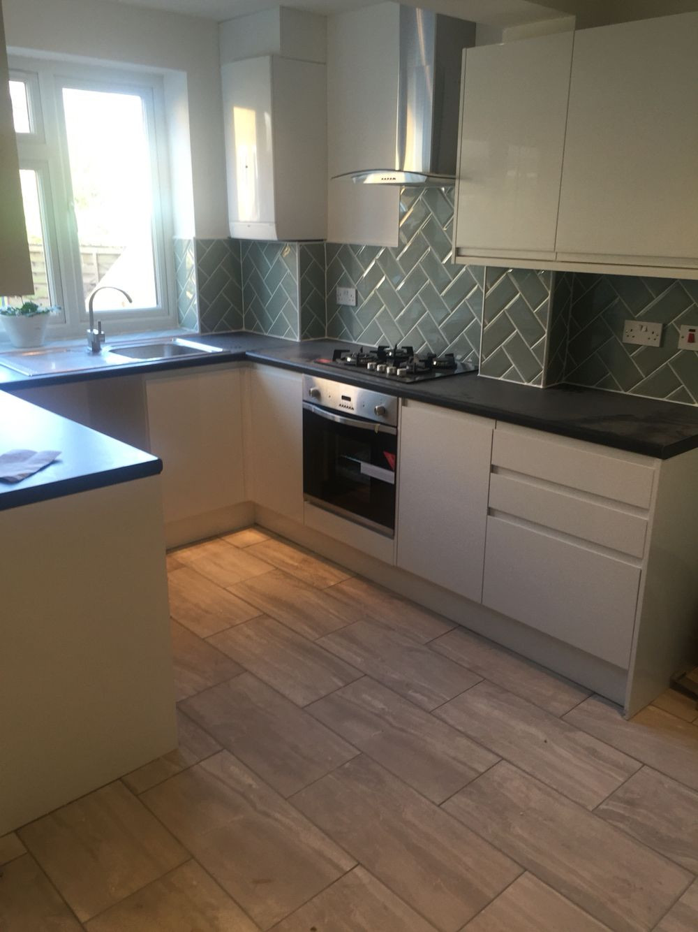 Higgins Hardwood Flooring Nh Of Handleless Gloss White Kitchen Complimented with Herringbone Duck Intended for Handleless Gloss White Kitchen Complimented with Herringbone Duck Egg Metro Wall Tiles with Stone Effect Floor Tiles