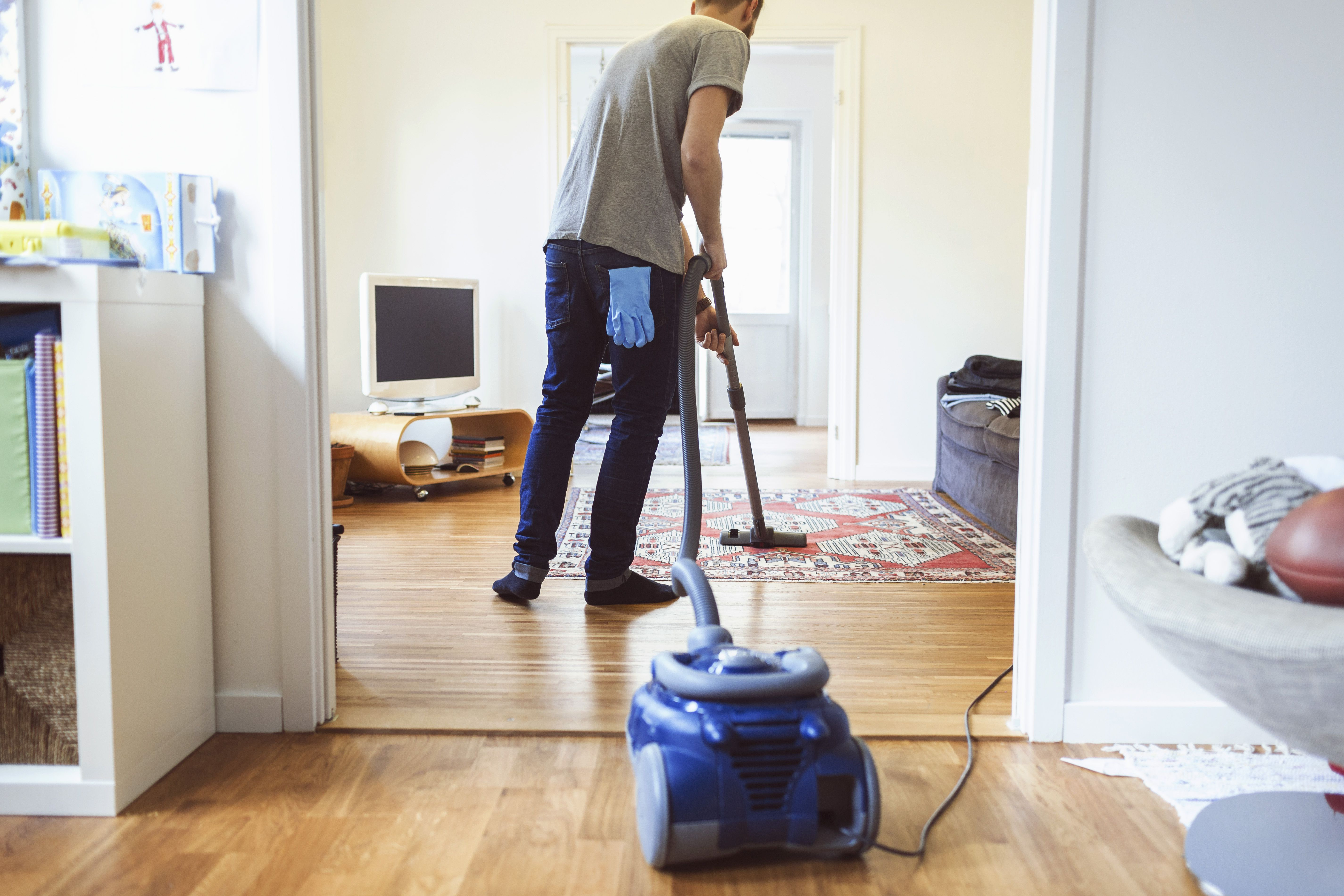 how to clean hardwood floors under carpet of 9 useful tips for eliminating house mites in rear view of man vacuuming carpet 562452131 5b04618b04d1cf003aa8304a
