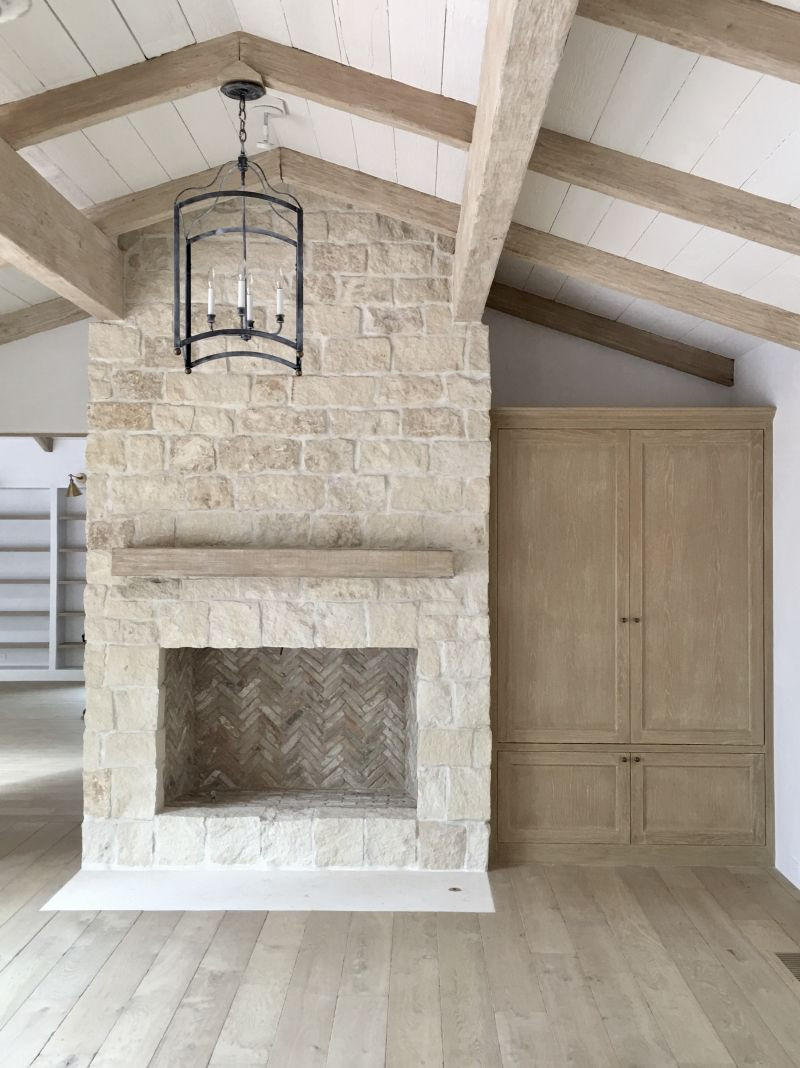how to install hardwood floor around fireplace of renovating our fireplace with stone veneers living room within light stone french fireplace brooke giannetti velvet linen http