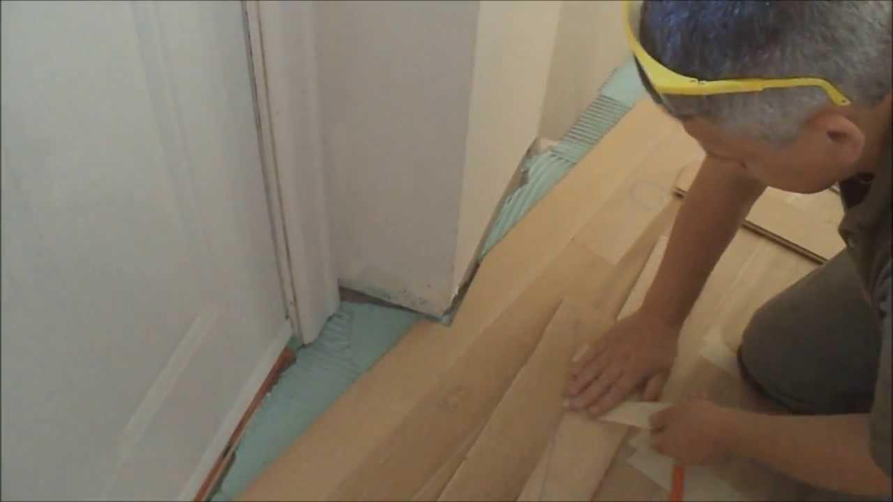 how to install hardwood floor in basement of how to install glue down hardwood floors over concrete in an uneven within how to install glue down hardwood floors over concrete in an uneven shaped room mryoucandoityourself youtube