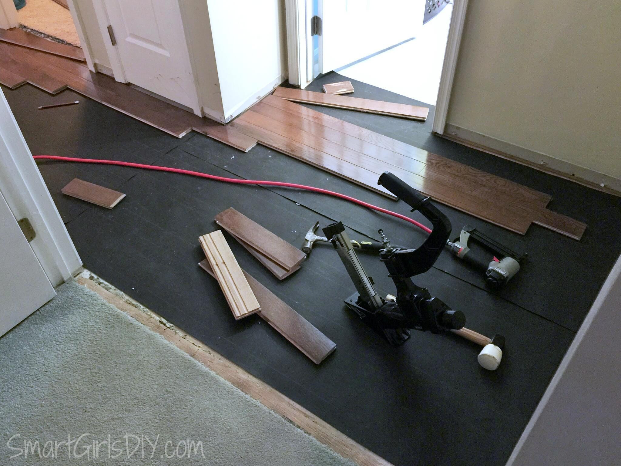 how to install hardwood floor threshold of upstairs hallway 1 installing hardwood floors inside working backwards to install hardwood from behind