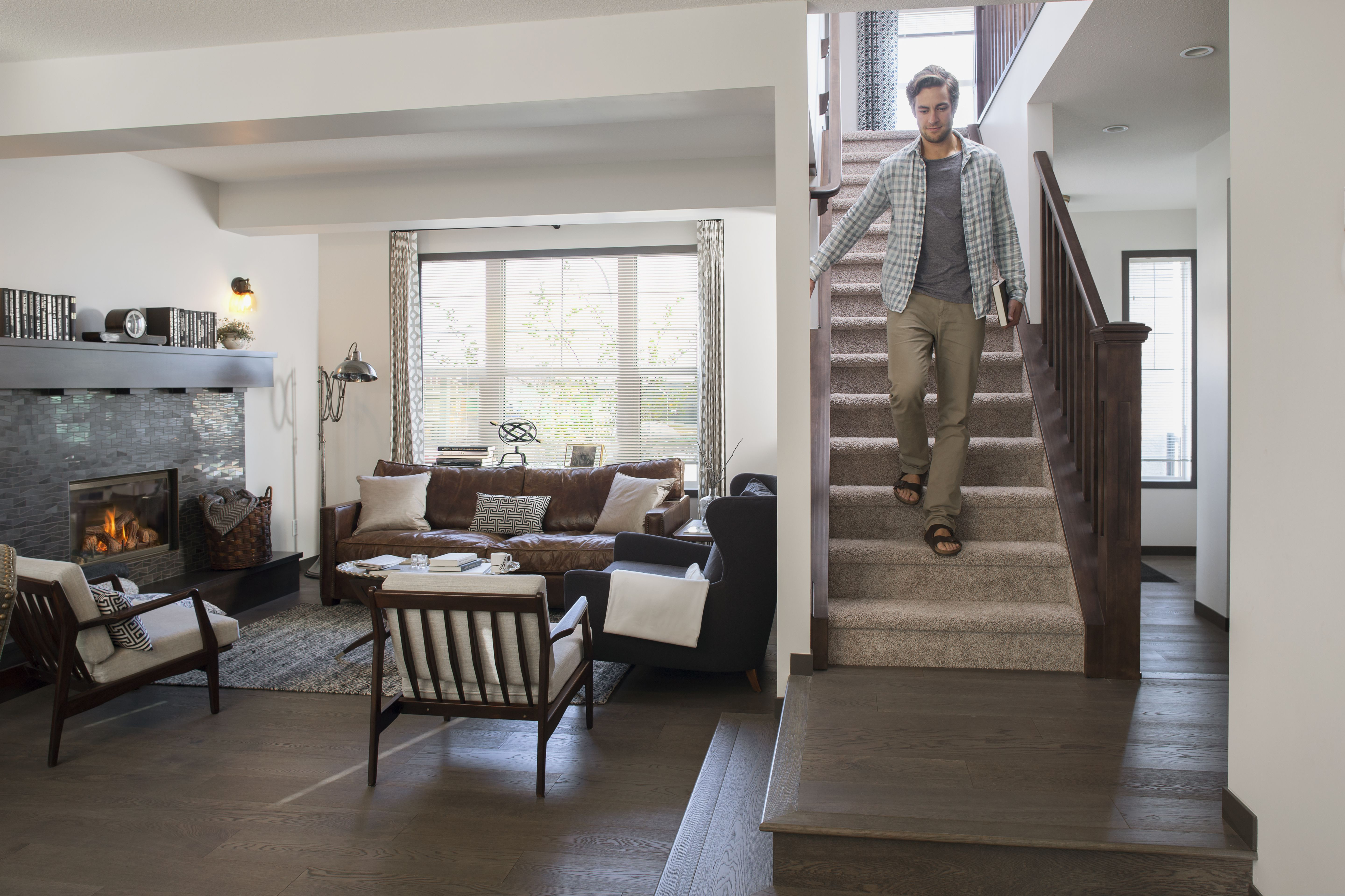 how to install hardwood floors on stairs landing of add metal balusters railings or posts to your stairs regarding man descending staircase in house 530054777 58d07c513df78c3c4fc8f060
