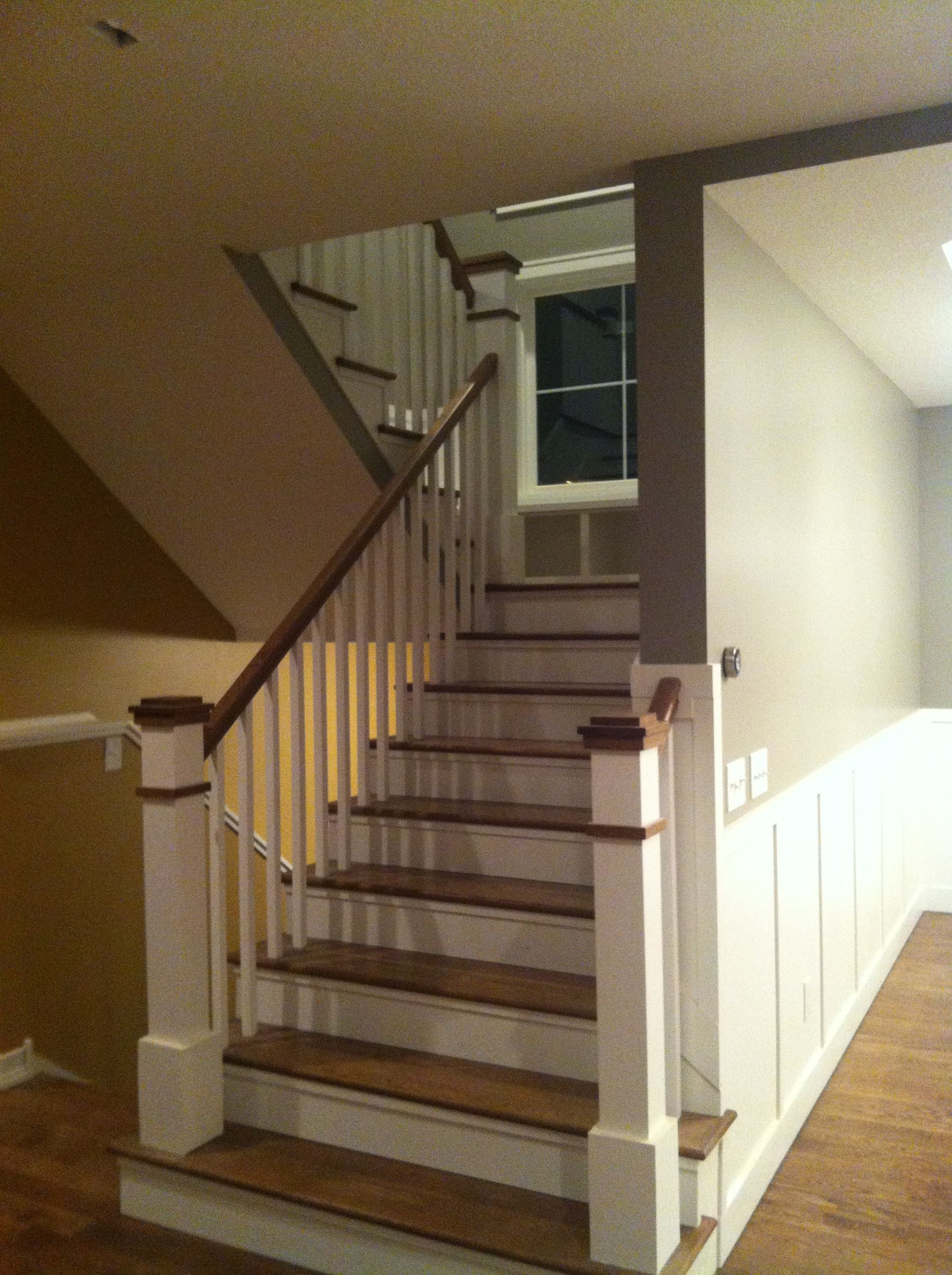 how to install hardwood floors on stairs landing of staircase window seat on landing custom newell post dark treads for staircase window seat on landing custom newell post dark treads white risers on stairs white balusters and dark stained railings and caps