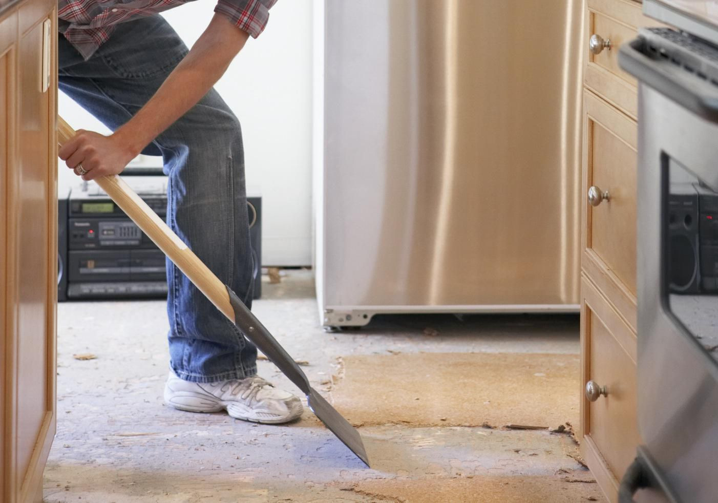 how to put down hardwood floor on concrete of flooring and cabinets which to install first with 200467183 001 56a49ecb3df78cf772834d10