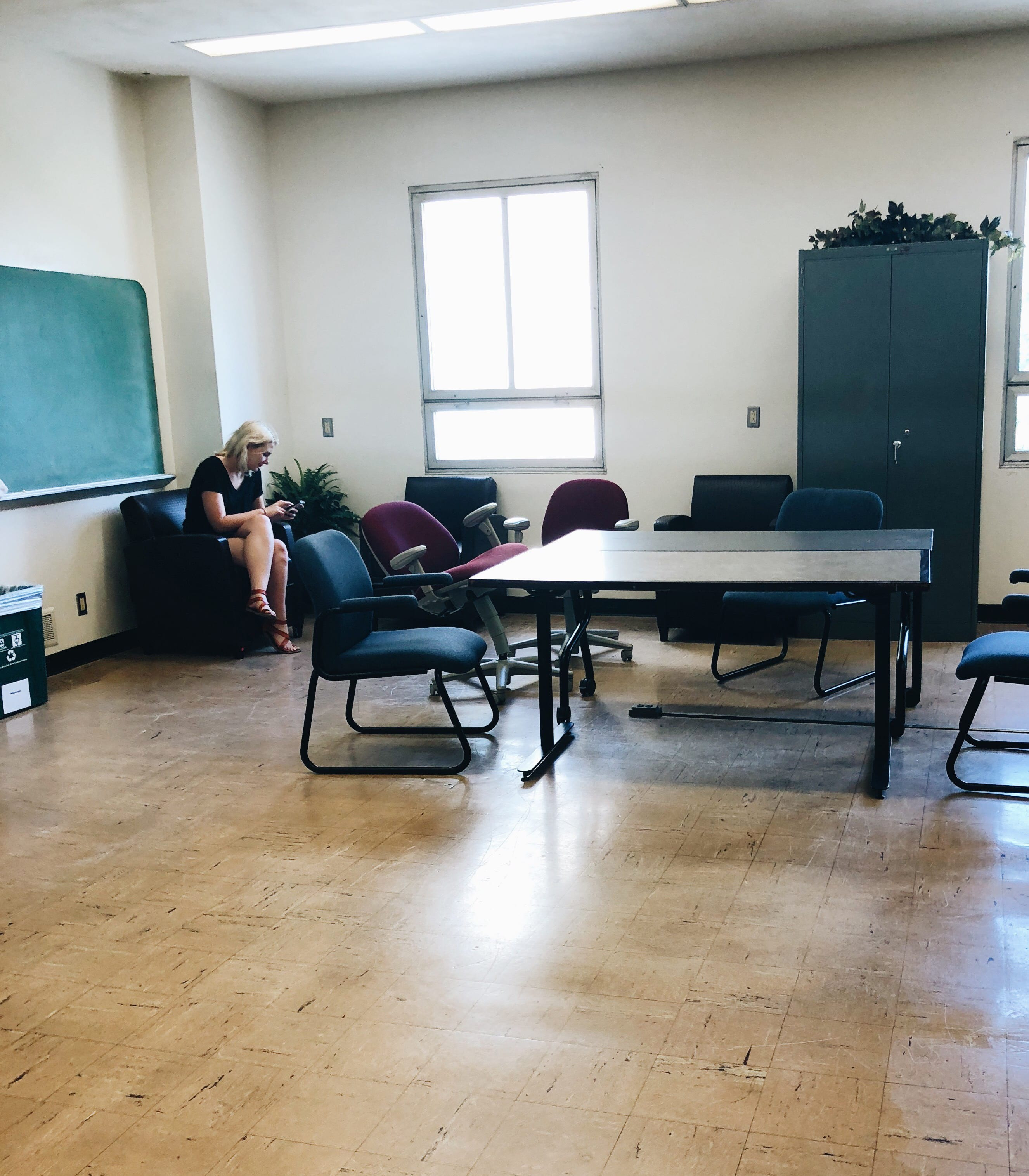 how to reverse hardwood floor direction of hale library blog intended for brenna sits in an armchair against the left wall nearby two tables are surrounded