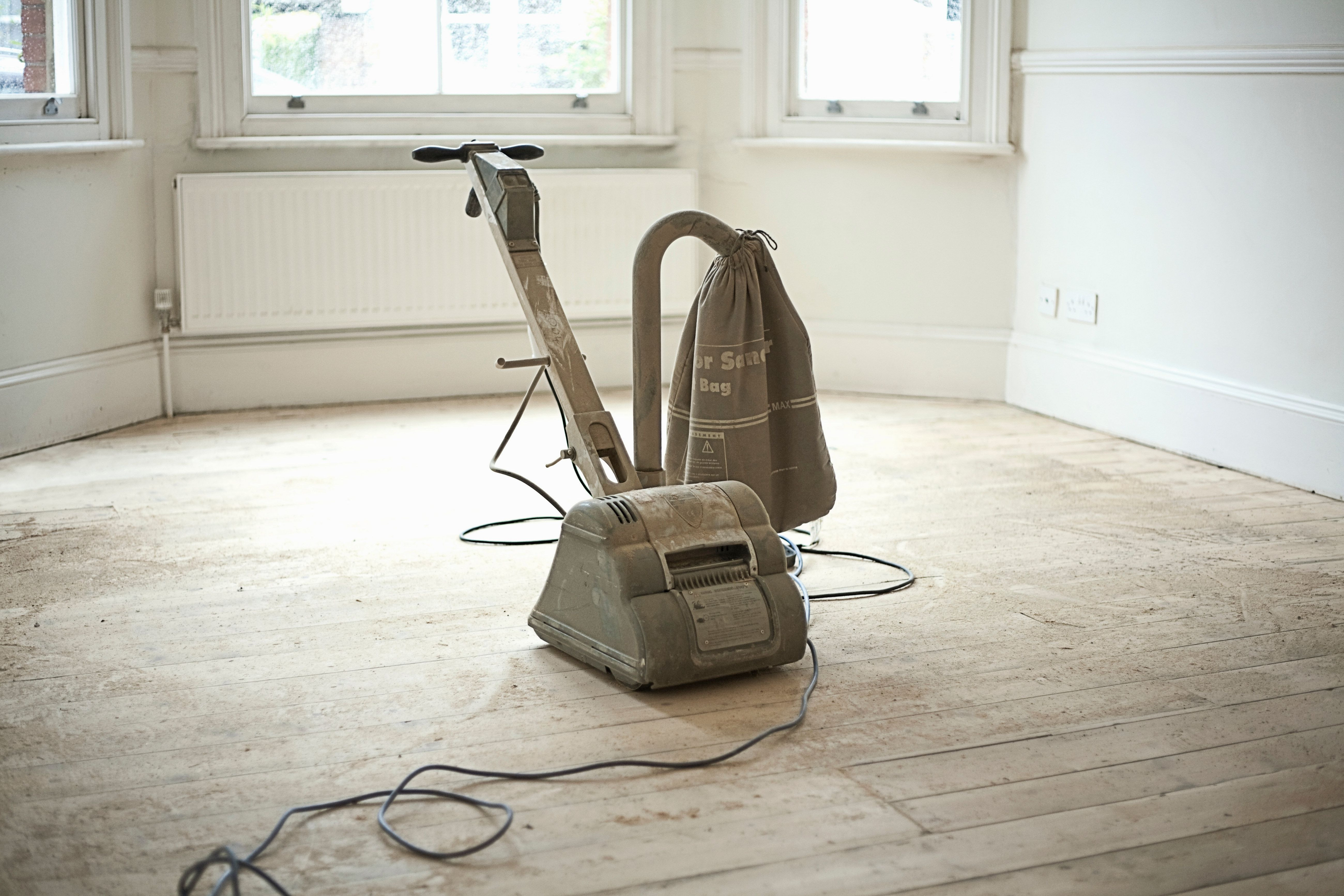 how to sand and refinish hardwood floors yourself of floor sanders to rent when finishing your wood floor inside sander on wooden floorboards of new home 179707189 588760815f9b58bdb3fed440