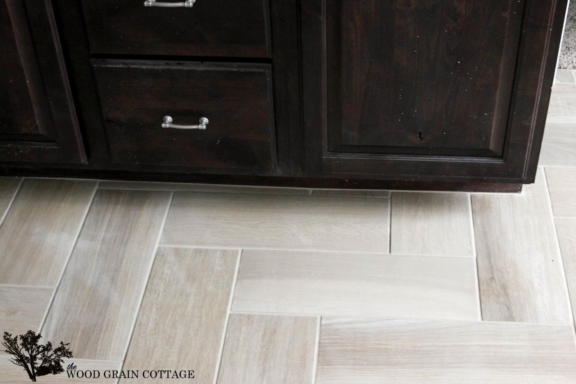 how to transition hardwood floor to tile of cute wood look bathroom tiles within floor transition laminate to in cute wood look bathroom tiles within floor transition laminate to herringbone tile pattern