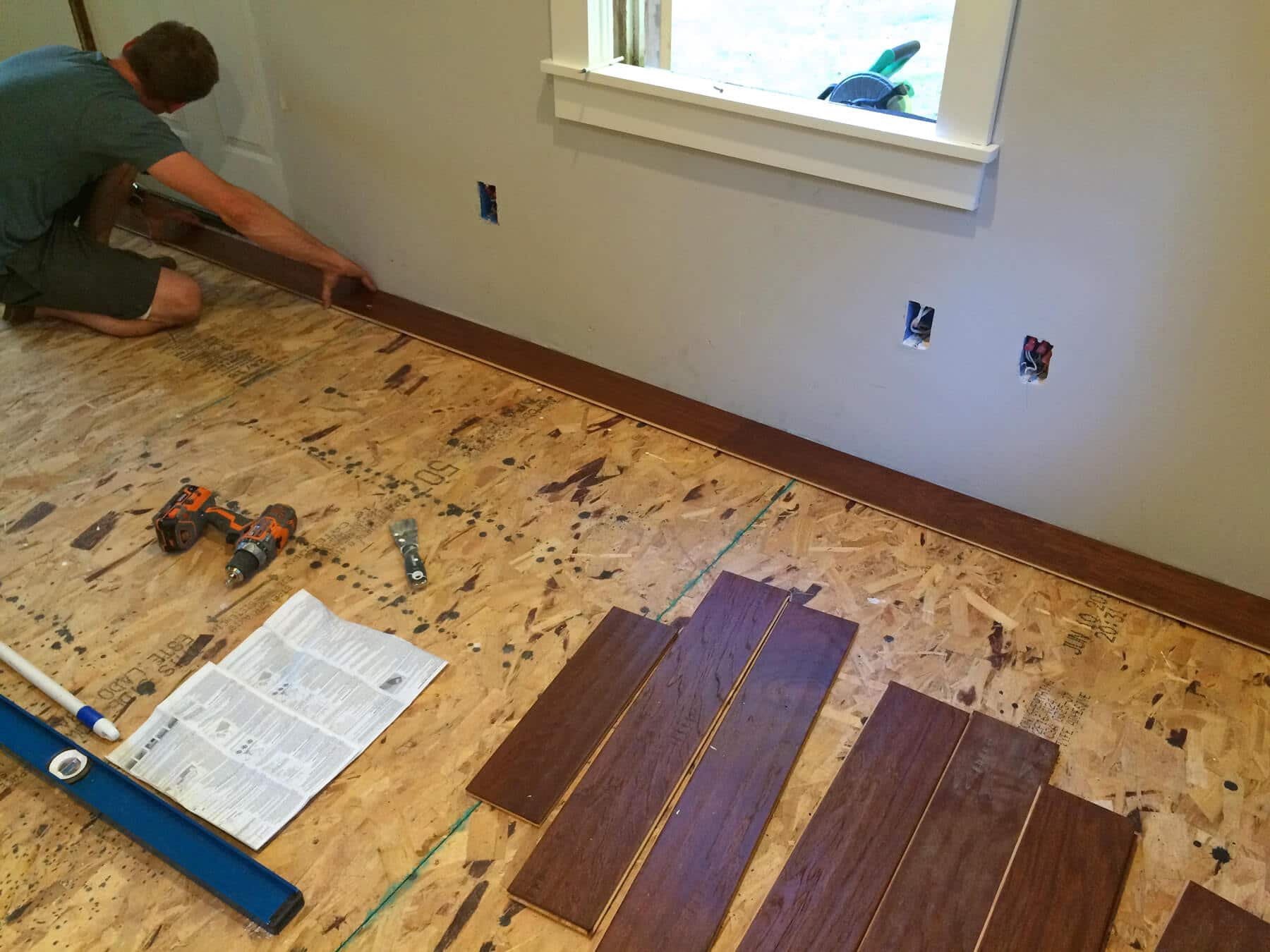 installing engineered hardwood flooring nail down of the micro dwelling project part 5 flooring the daring gourmet pertaining to the nails in the first row have to be face nailed down as close to the wall as possible so that the baseboards will cover the nails