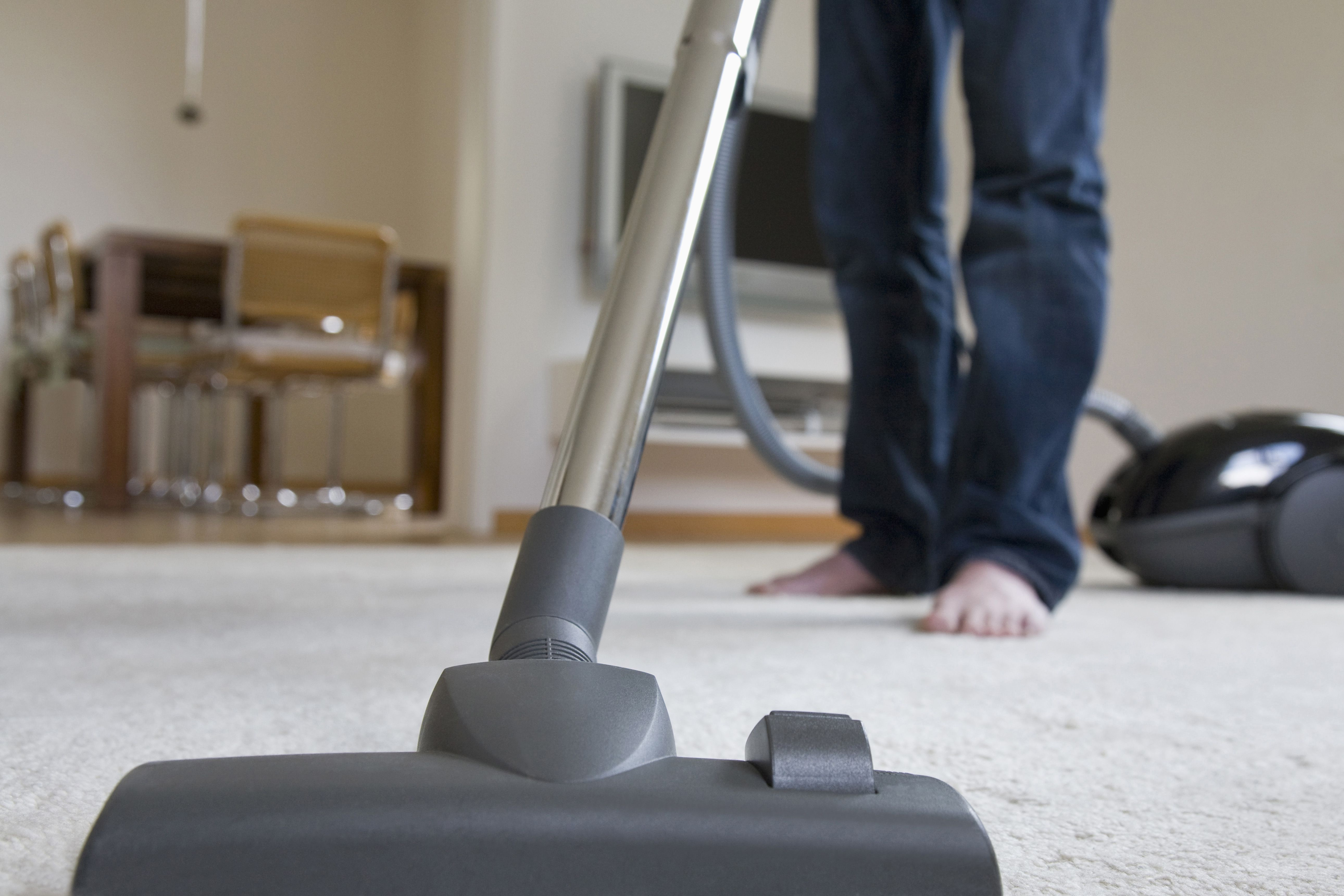 kirby hardwood floor care kit of you should not use a regular vacuum to clean ash for germany baden wurttemberg stuttgart man vacuuming carpet low section 166275697 59dd3ebe22fa3a0011e54df7