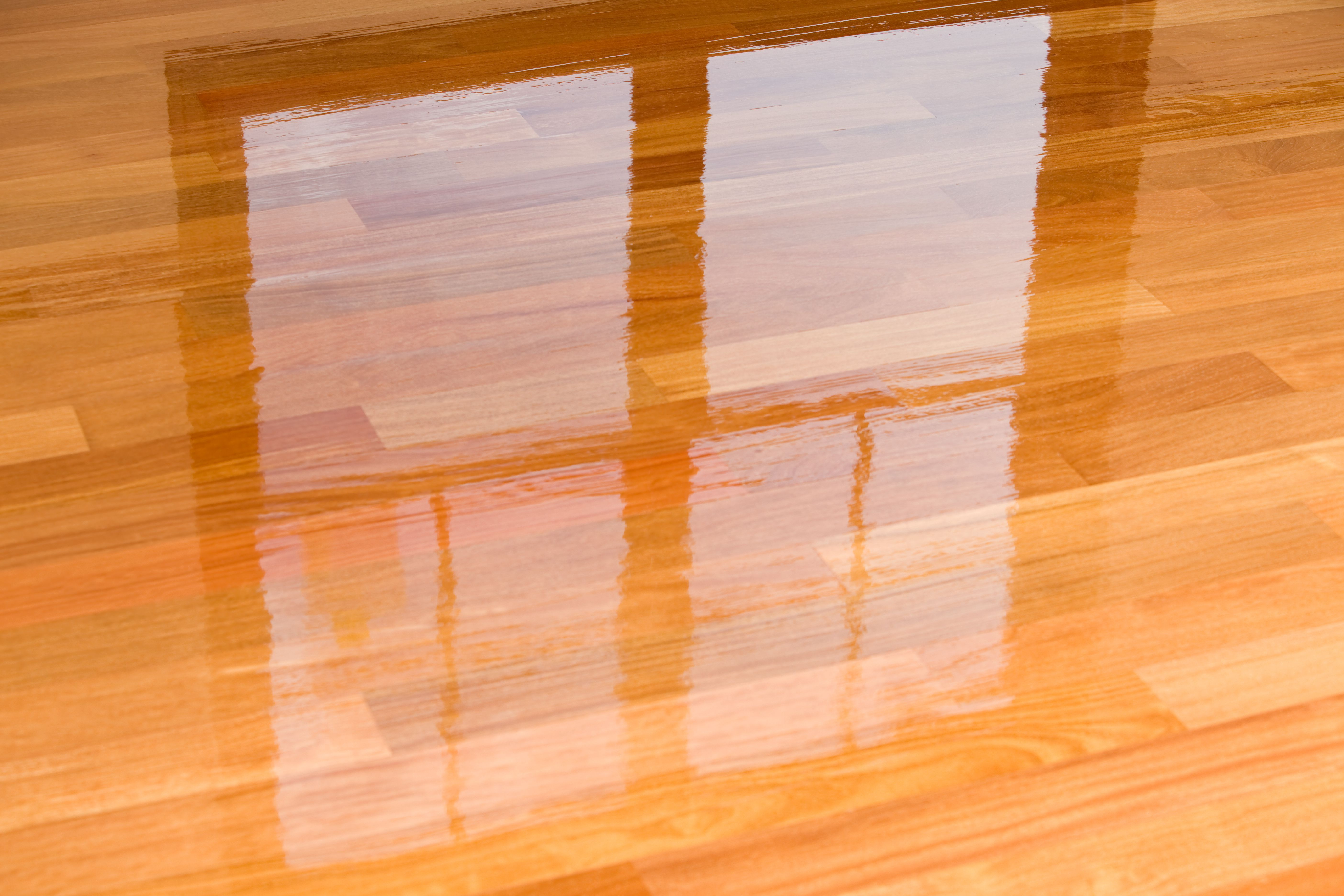 laminate hardwood floor cleaner of guide to laminate flooring water and damage repair throughout wet polyurethane on new hardwood floor with window reflection 183846705 582e34da3df78c6f6a403968