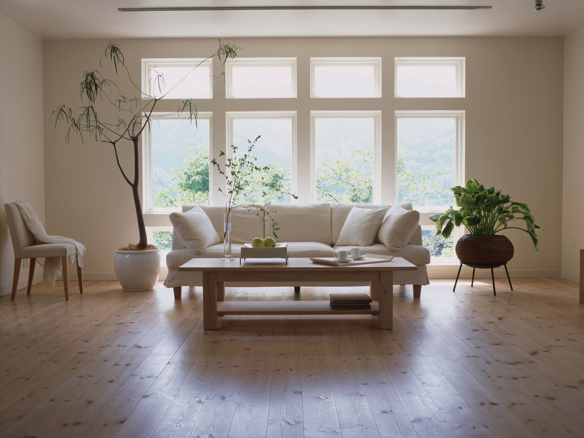 laminate hardwood flooring reviews of laminate flooring pros and cons with living room laminate floor gettyimages dexph070 001 58b5cc793df78cdcd8be2938