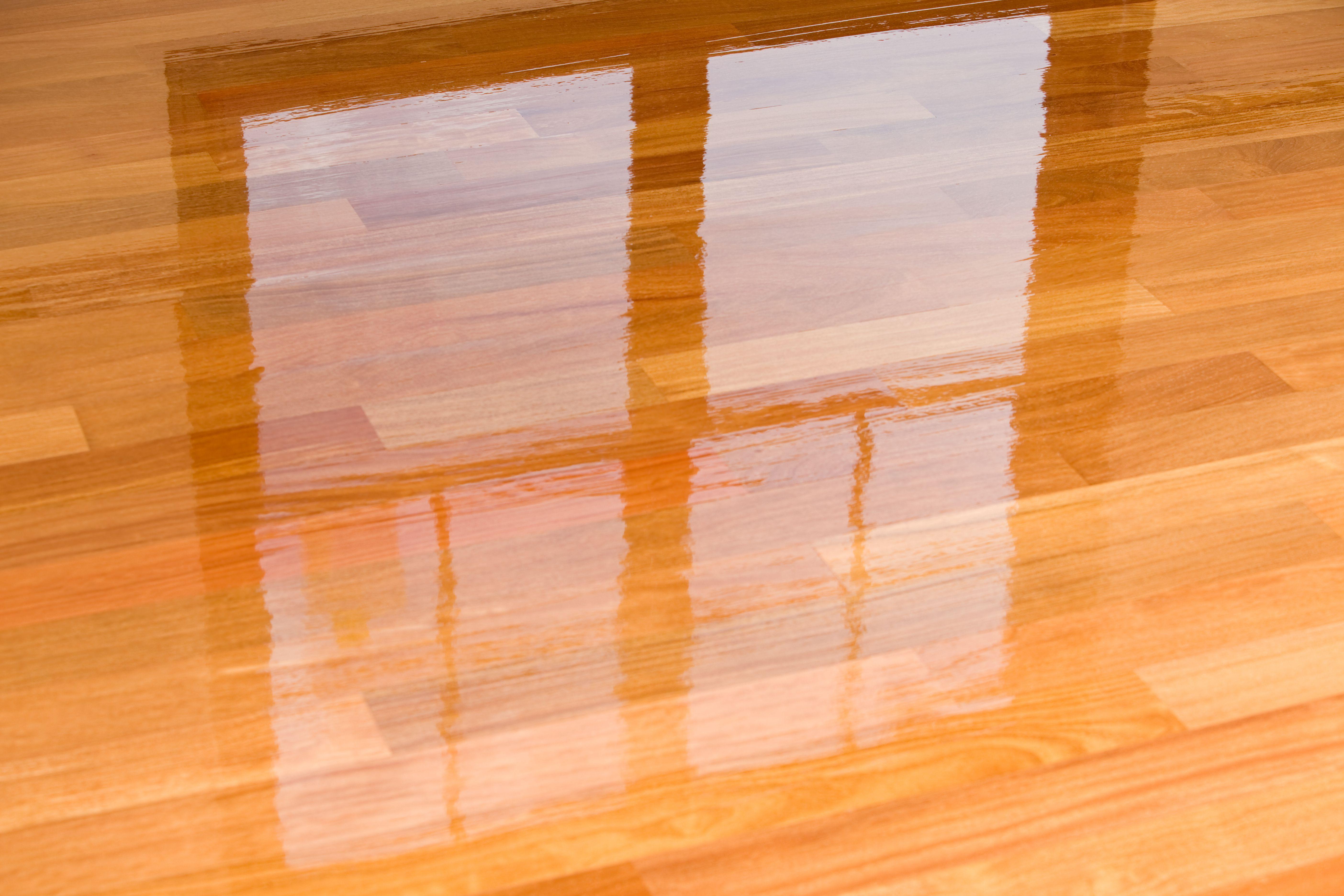 laminate hardwood flooring water damage of guide to laminate flooring water and damage repair with regard to wet polyurethane on new hardwood floor with window reflection 183846705 582e34da3df78c6f6a403968