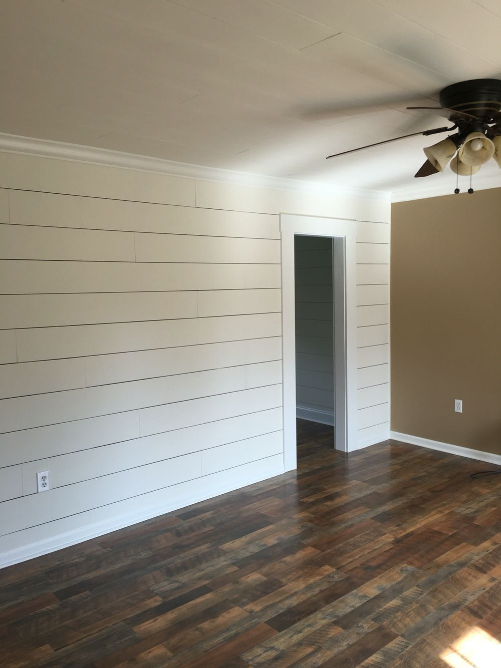 large gaps in hardwood floors of client remodel faux shiplap wall with larger 1 8 spacing and pergo pertaining to faux shiplap wall with larger 1 8 spacing and pergo max flooring in river road oak