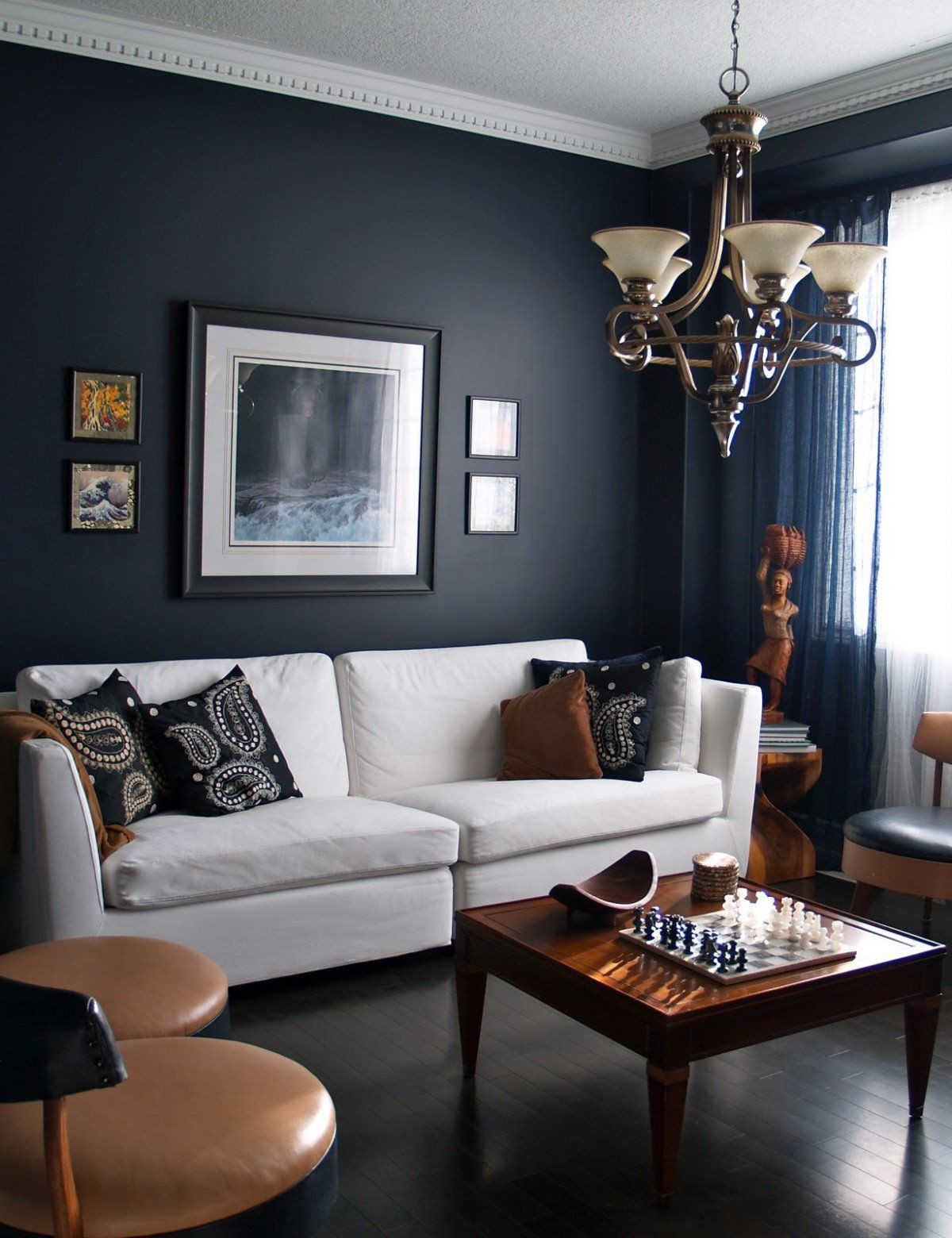 light hardwood floor living room ideas of 15 beautiful dark blue wall design ideas living room designs in living rooms with dark navy blue walls with white sofa and classic chandelier