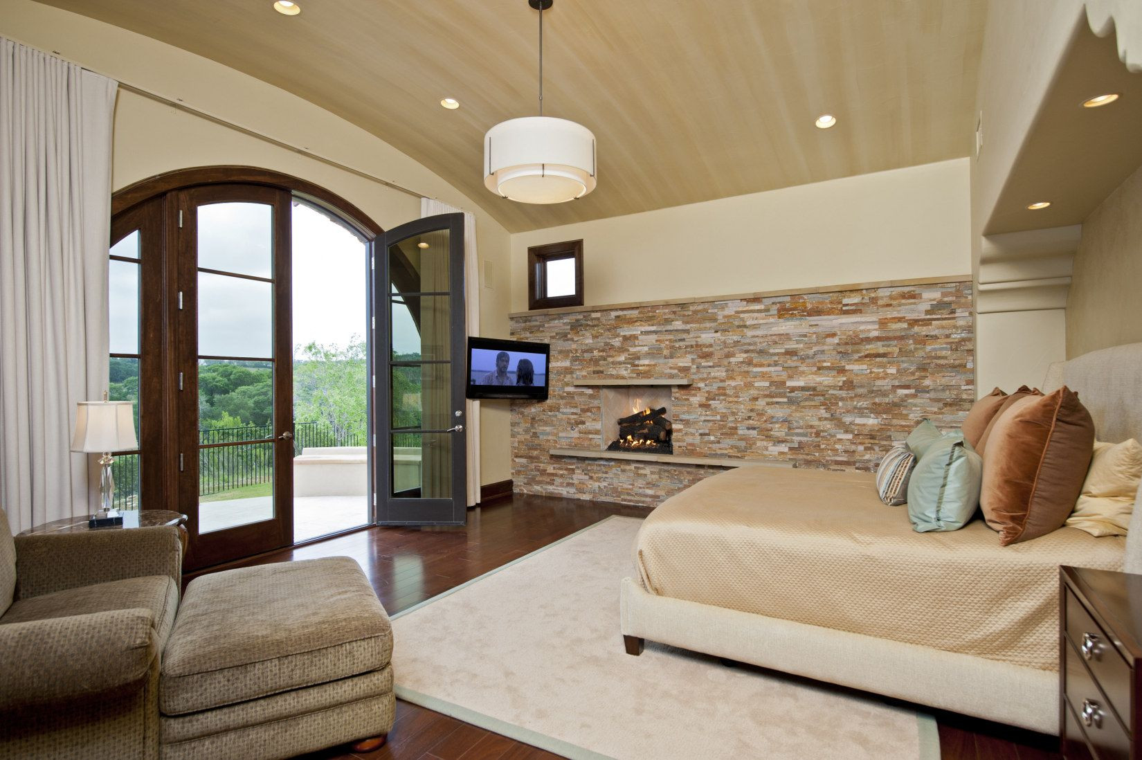 master bedroom hardwood floor pictures of contemporary tuscan vernacular master bedroom rooms pinterest with brick wall contemporary master bedroom with emerald latrice brown chair and ottoman set flush light hardwood floors french doors